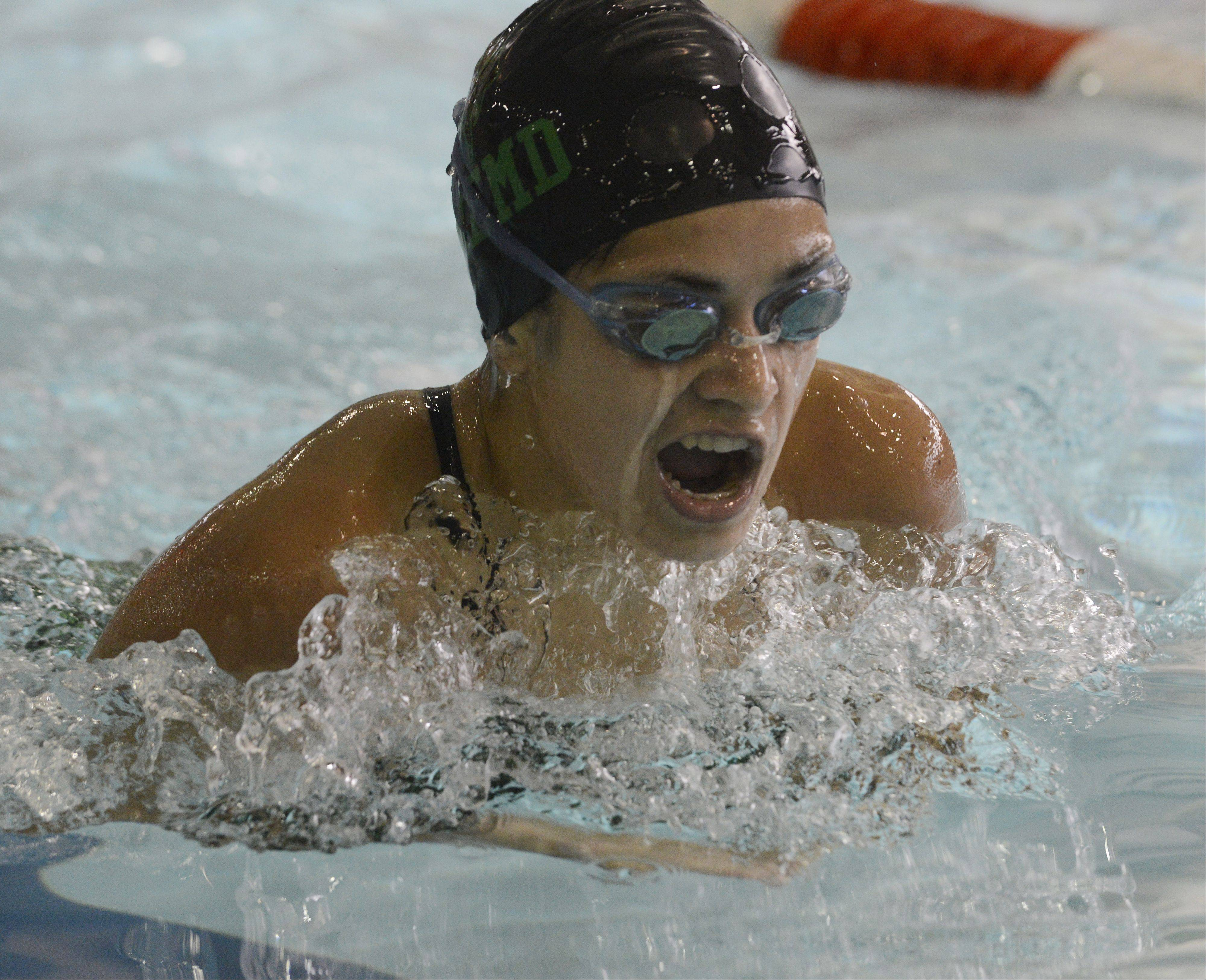 Fremd's Grace Grzybek swims breaststroke in the 200-yard individual medley during Tuesday's meet at Olympic Pool in Arlington Heights.