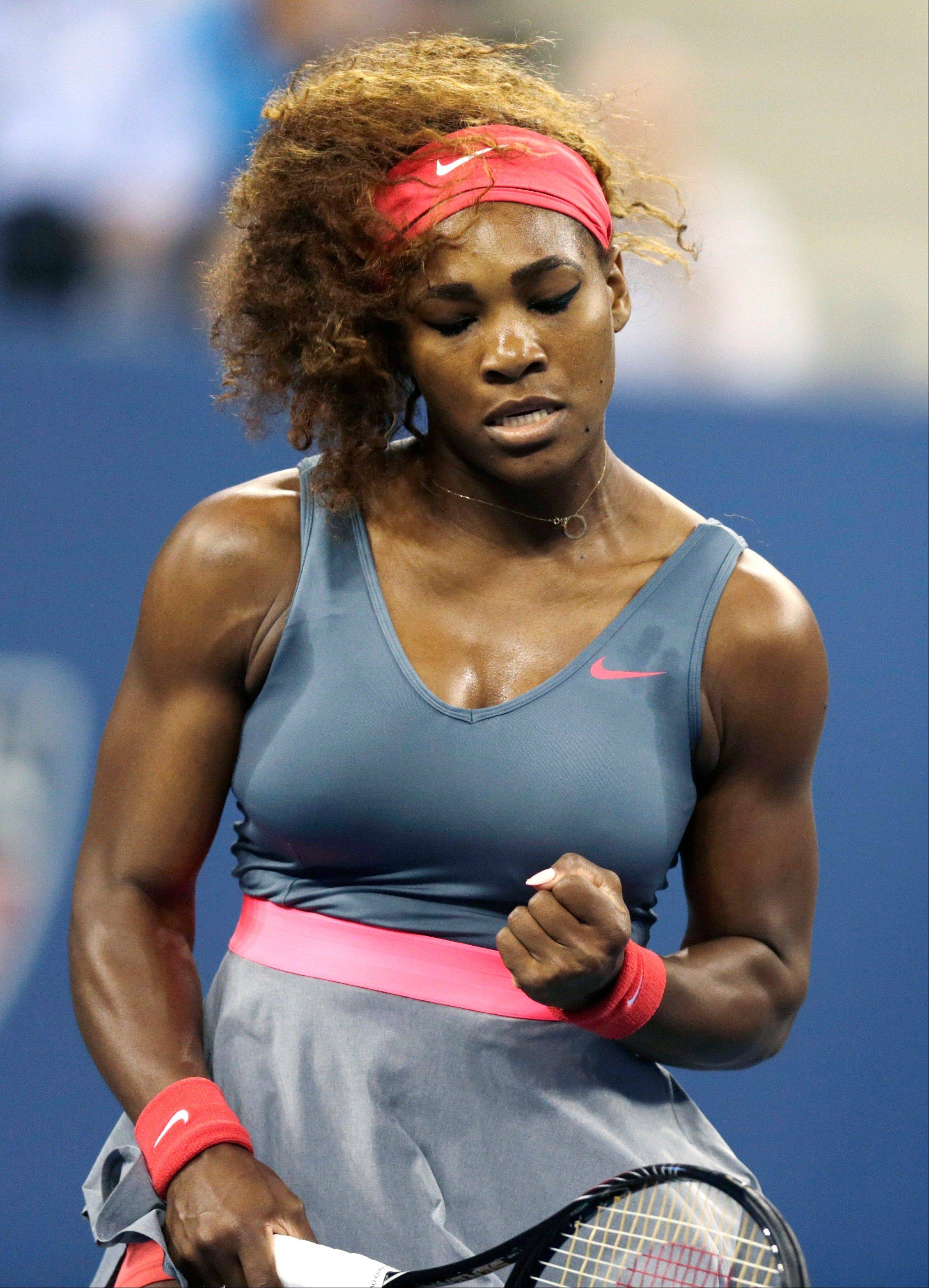 Serena Williams, of the United States, pumps her fist after winning a point against Carla Suarez Navarro, of Spain, during a quarterfinal of the U.S. Open tennis tournament, Tuesday, Sept. 3, 2013, in New York.