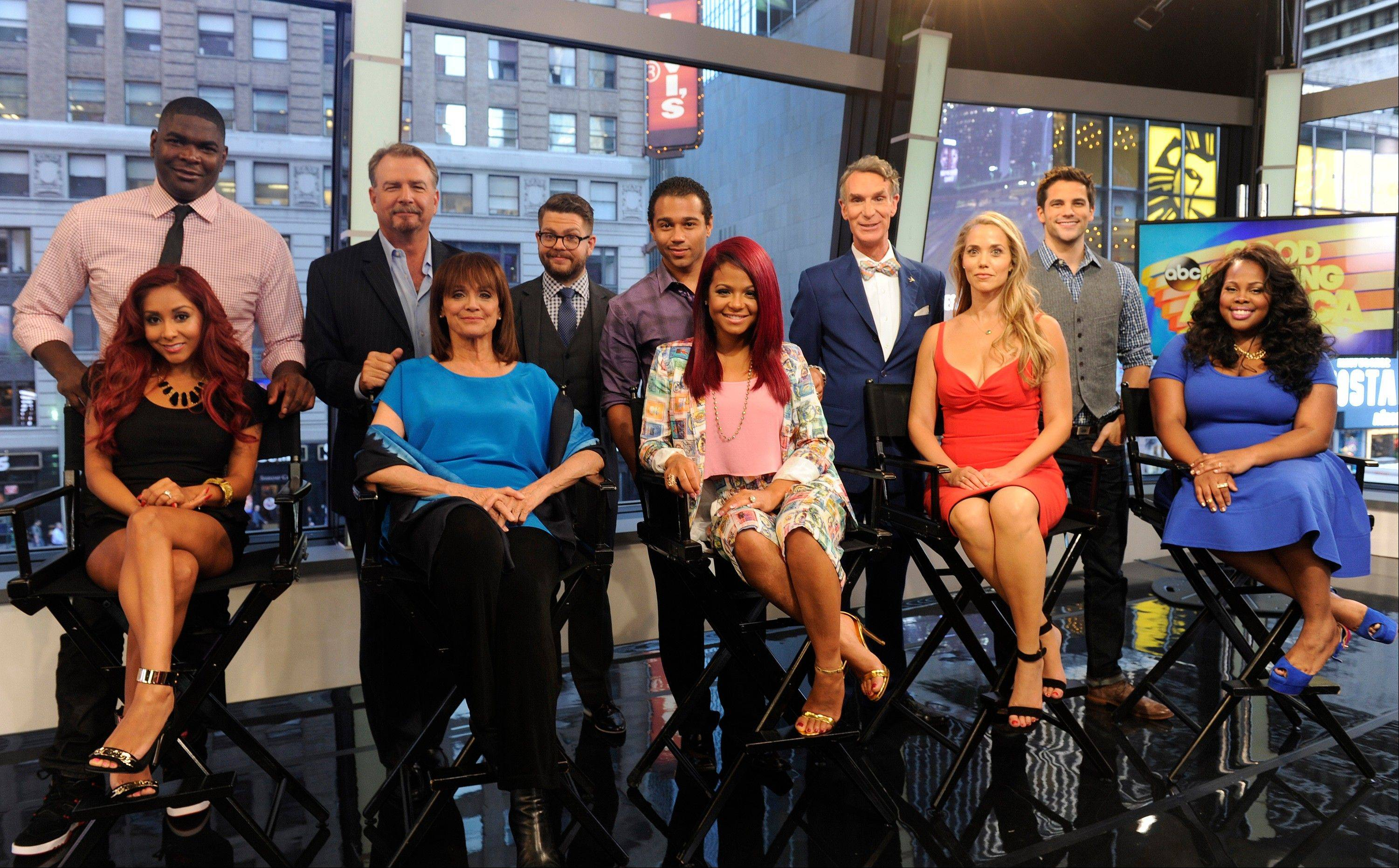 "This image released by ABC shows, standing from left, NFL wide receiver Keyshawn Johnson, comic Bill Engvall, TV personality Jack Osbourne, actor Corbin Bleu, Bill Nye, the ""Science Guy,"" actor Brant Daugherty, and seated from left, TV personality Nicole ""Snooki"" Polizzi, actress Valerie Harper, singer-actress Christina Milian, actress Elizabeth Berkley and actress Amber Riley on ""Good Morning America,"" Wednesday, Sept. 4, 2013 in New York. These 11 celebrities, along with actress Leah Remini, will be the next celebrity contestants on the dance competition series ""Dancing with the Stars,"" premiering Sept. 16. (AP Photo/ABC, Ida Mae Astute)"