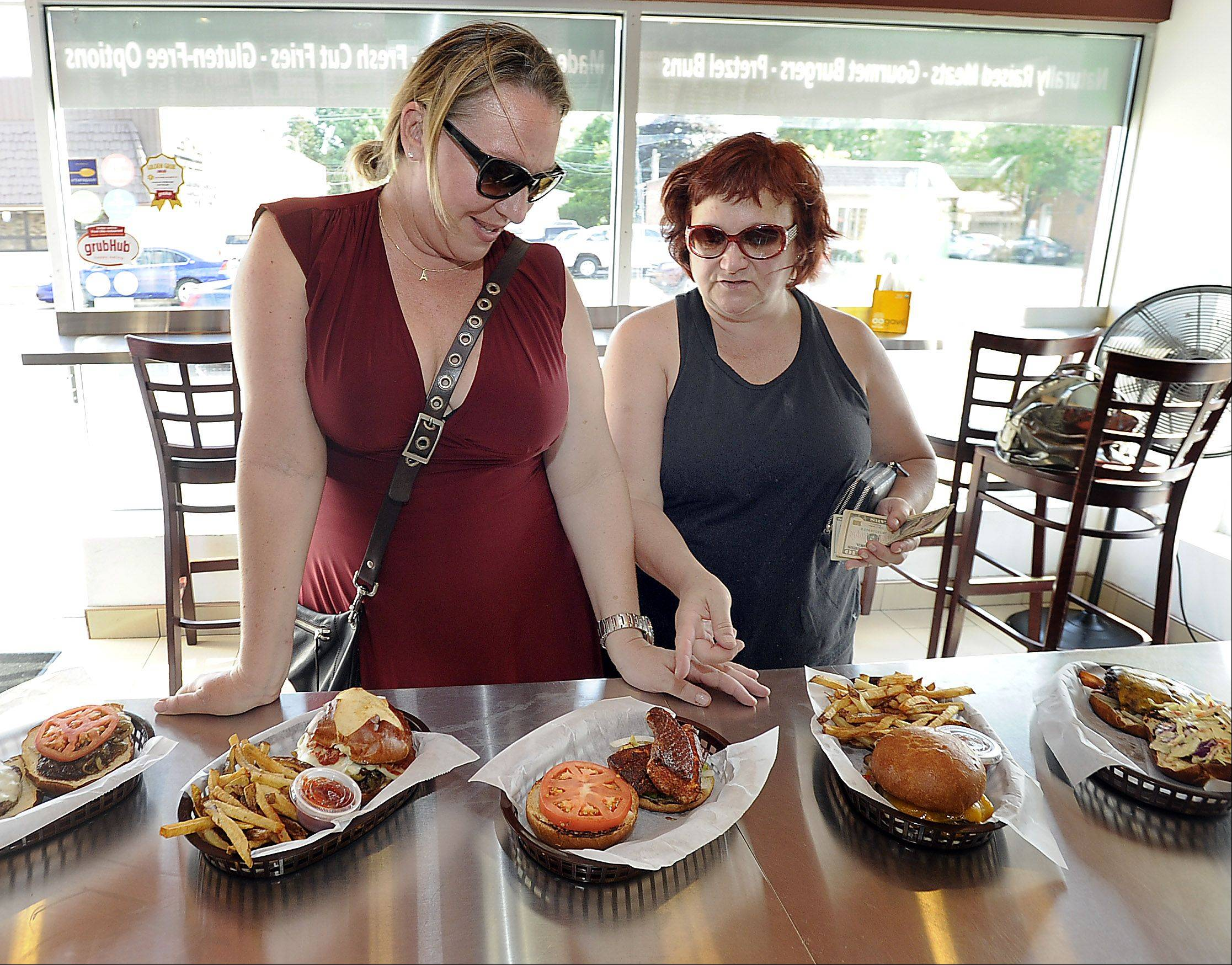 Paula Vazzell of Los Angeles and friend Karol Kent of Des Plaines check out the selection at American Wildburger in Des Plaines.