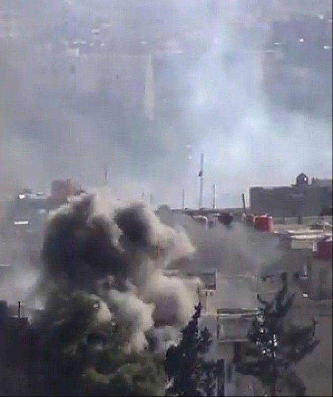 In this image taken from video obtained from the Shaam News Network, which has been authenticated based on its contents and other AP reporting, smoke rises from buildings due to heavy clashes between Free Syrian army fighters and government forces in Daraya, a suburb of Damascus, Syria, Wednesday.