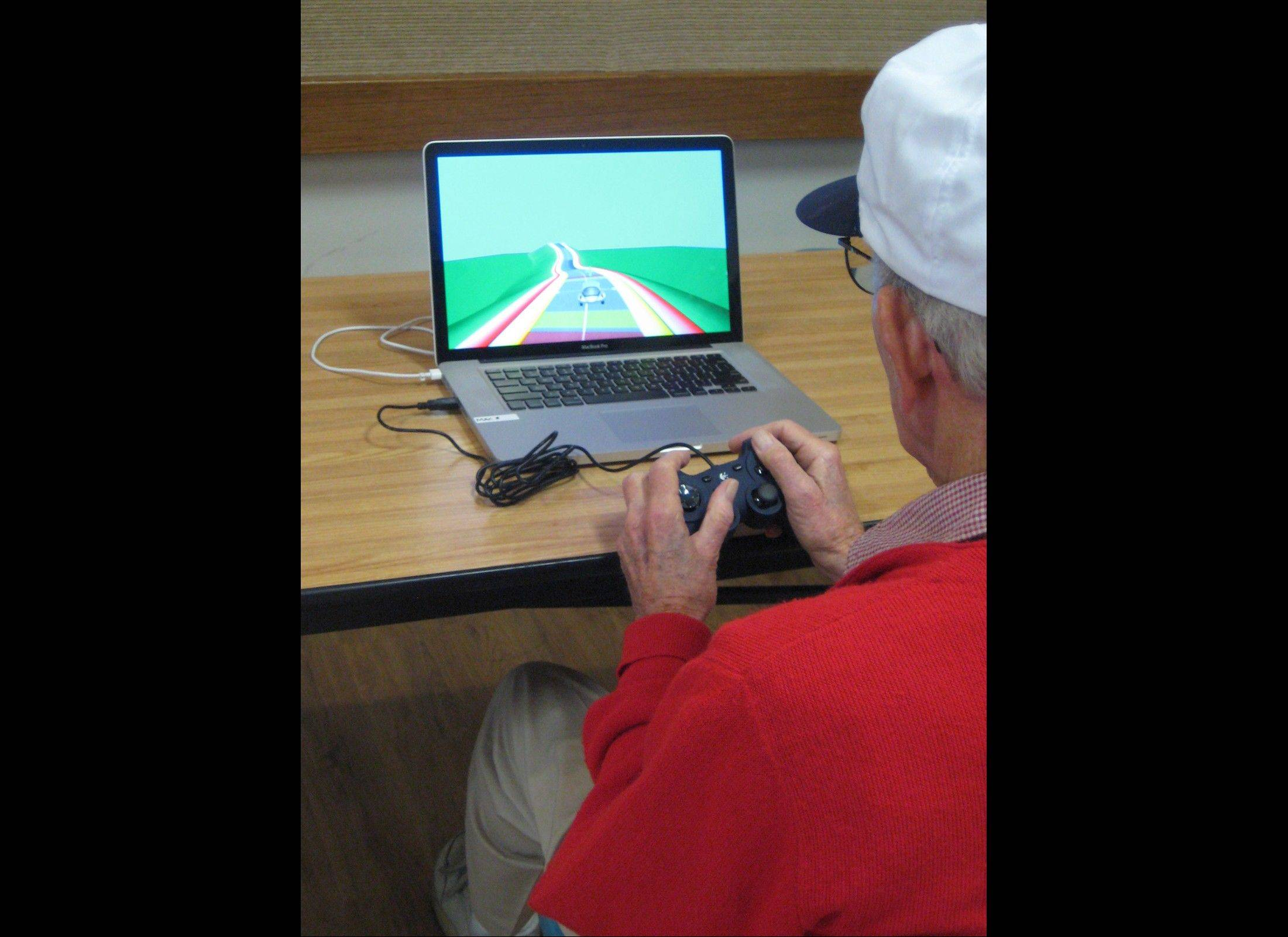 A study participant plays NeuroRacer in San Francisco. A preliminary study released Wednesday suggests the game may help people in their 60s and older boost mental abilities like handling multiple tasks at once.