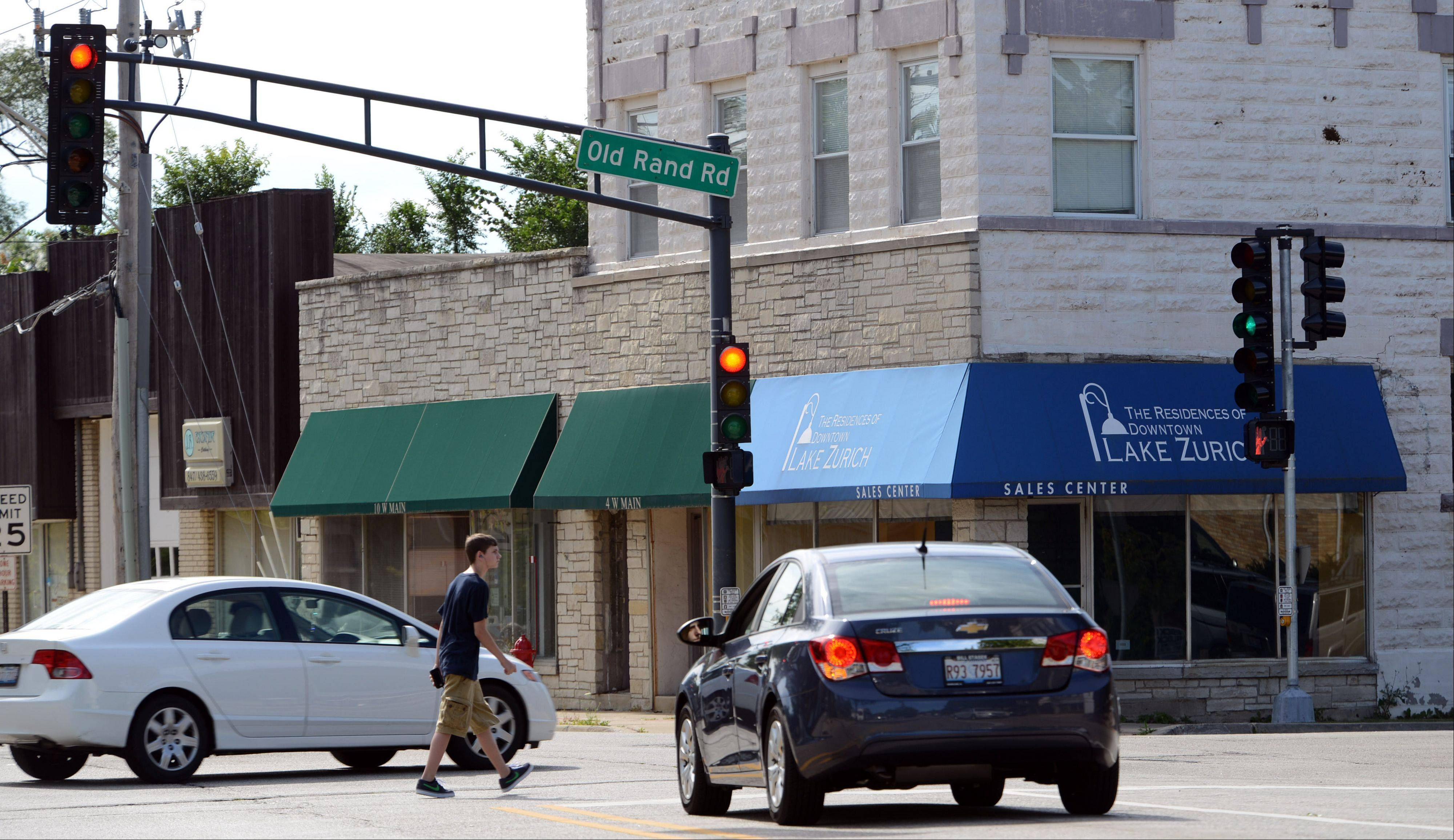 Lake Zurich village board members have approved spending nearly $116,000 to tear down five buildings as part of an effort to assist in downtown redevelopment including these buildings along West Main Street.