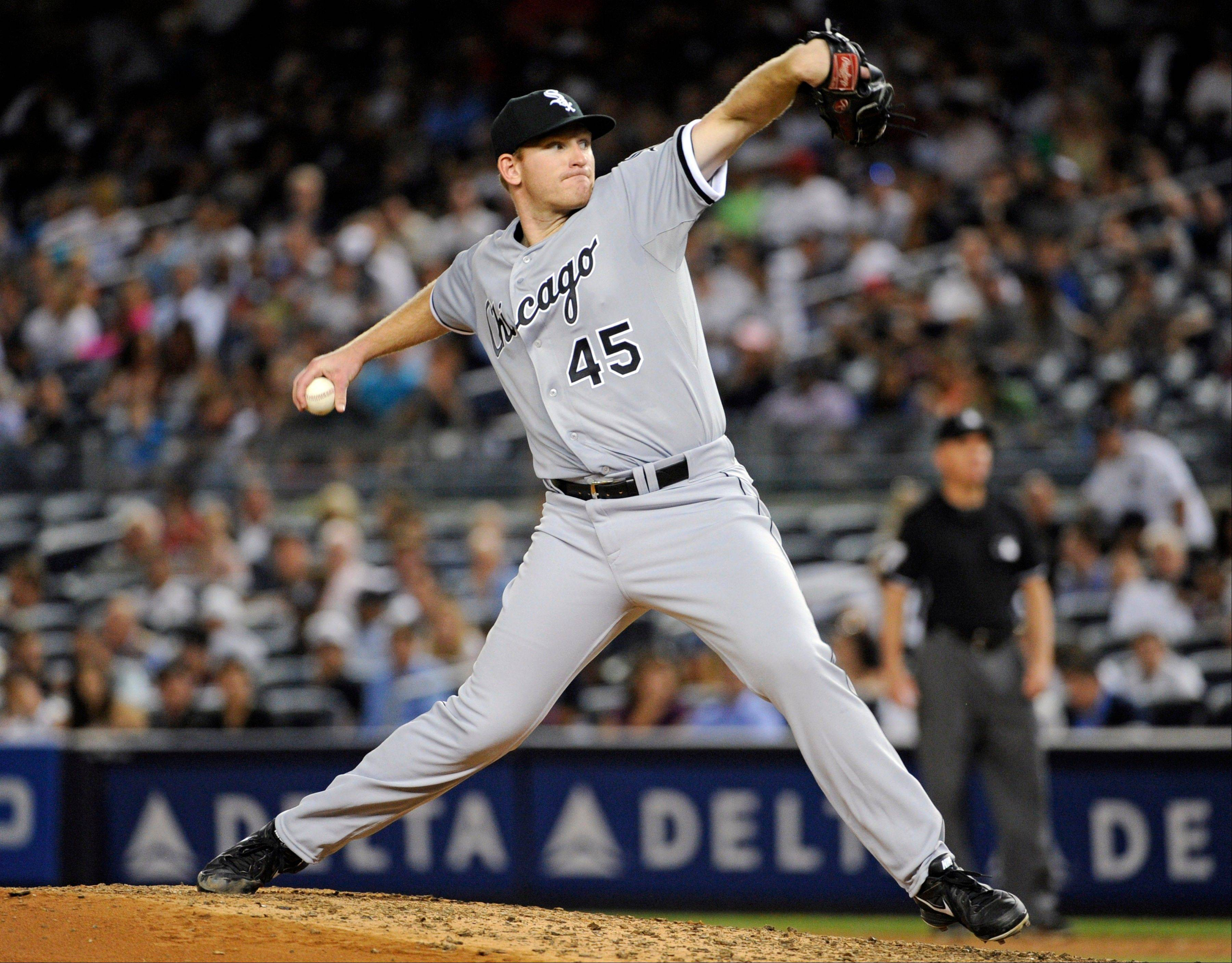 White Sox pitcher Erik Johnson delivers the ball to the New York Yankees during Wednesday night�s game in New York. It was Johnson�s first major-league outing, which the Sox lost 6-5.