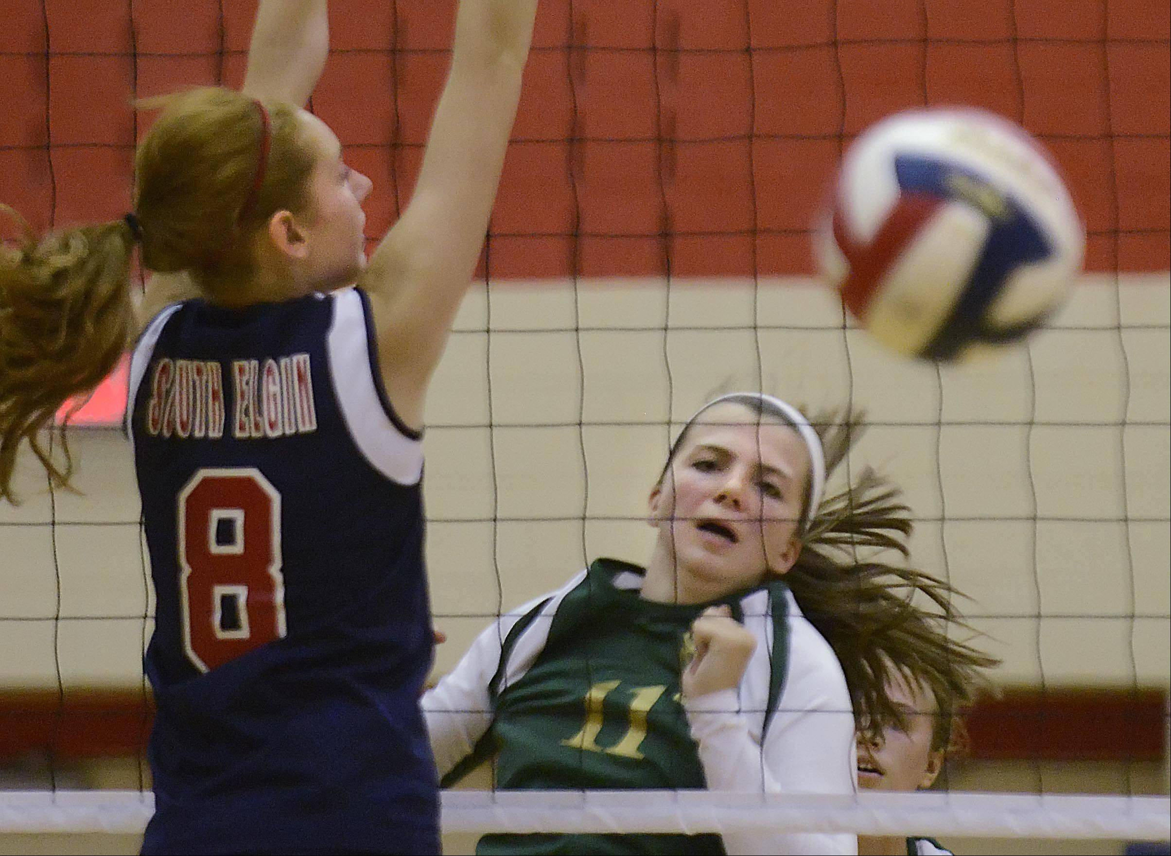 St. Edward�s Katie Swanson watches her shot go past South Elgin�s Sarah Hallas Wednesday in South Elgin.