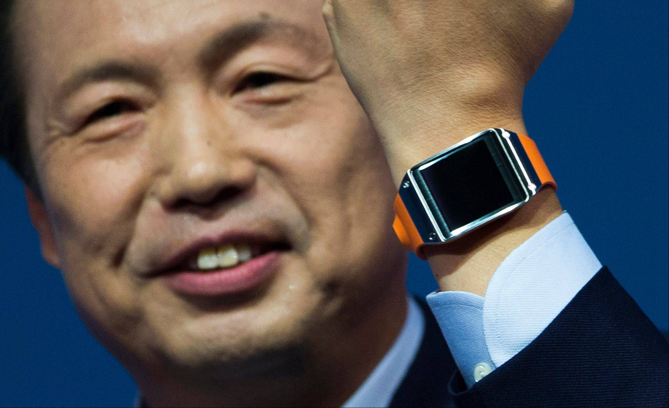 JK Shin, head of Samsung Mobile Communications, presents the Samsung Galaxy Gear in Berlin, Germany, Wednesday. Samsung has unveiled a highly anticipated digital wristwatch well ahead of a similar product expected from rival Apple.