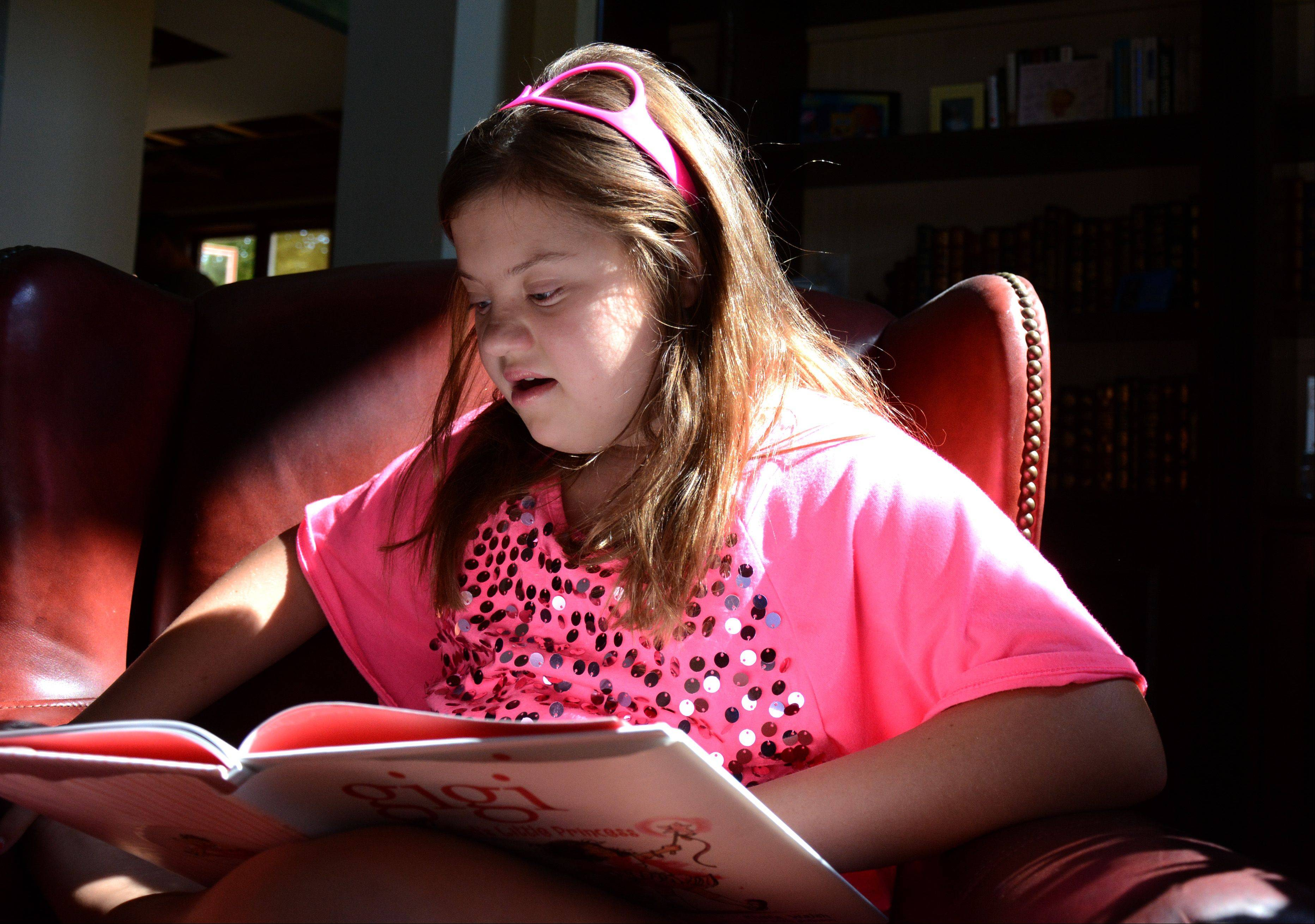 GiGi Gianni reads a book at her home in South Barrington.
