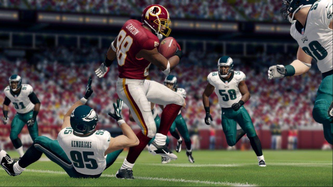 "An animated version of Redskins' Pierre Garcon, center, runs through the pack in ""Madden NFL 25."""