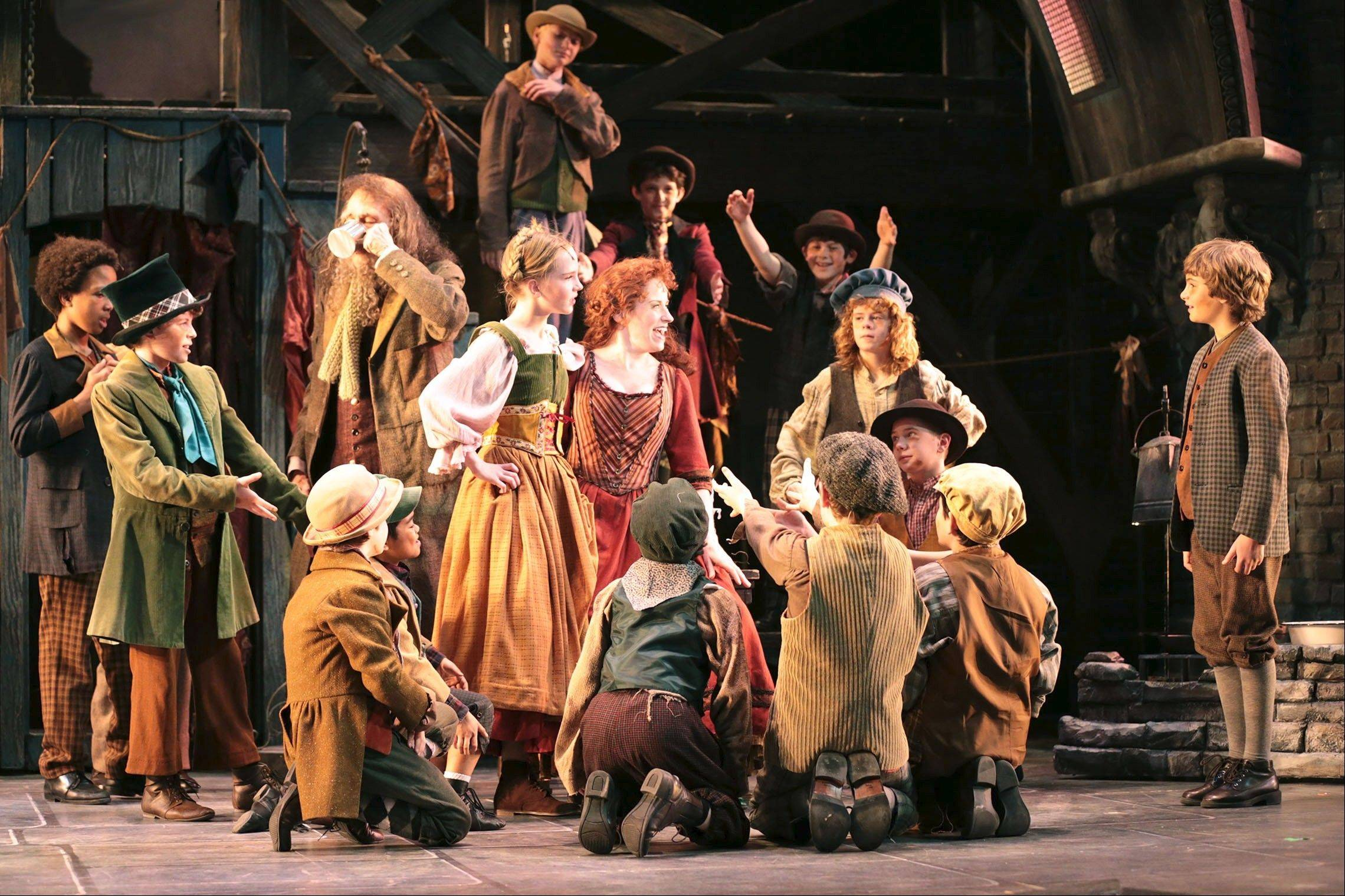 "Heidi Kettenring, in red, received a Joseph Jefferson Award nomination for her performance as Nancy in Drury Lane Theatre's ""Oliver,"" which also earned Rachel Rockwell a directing nomination."