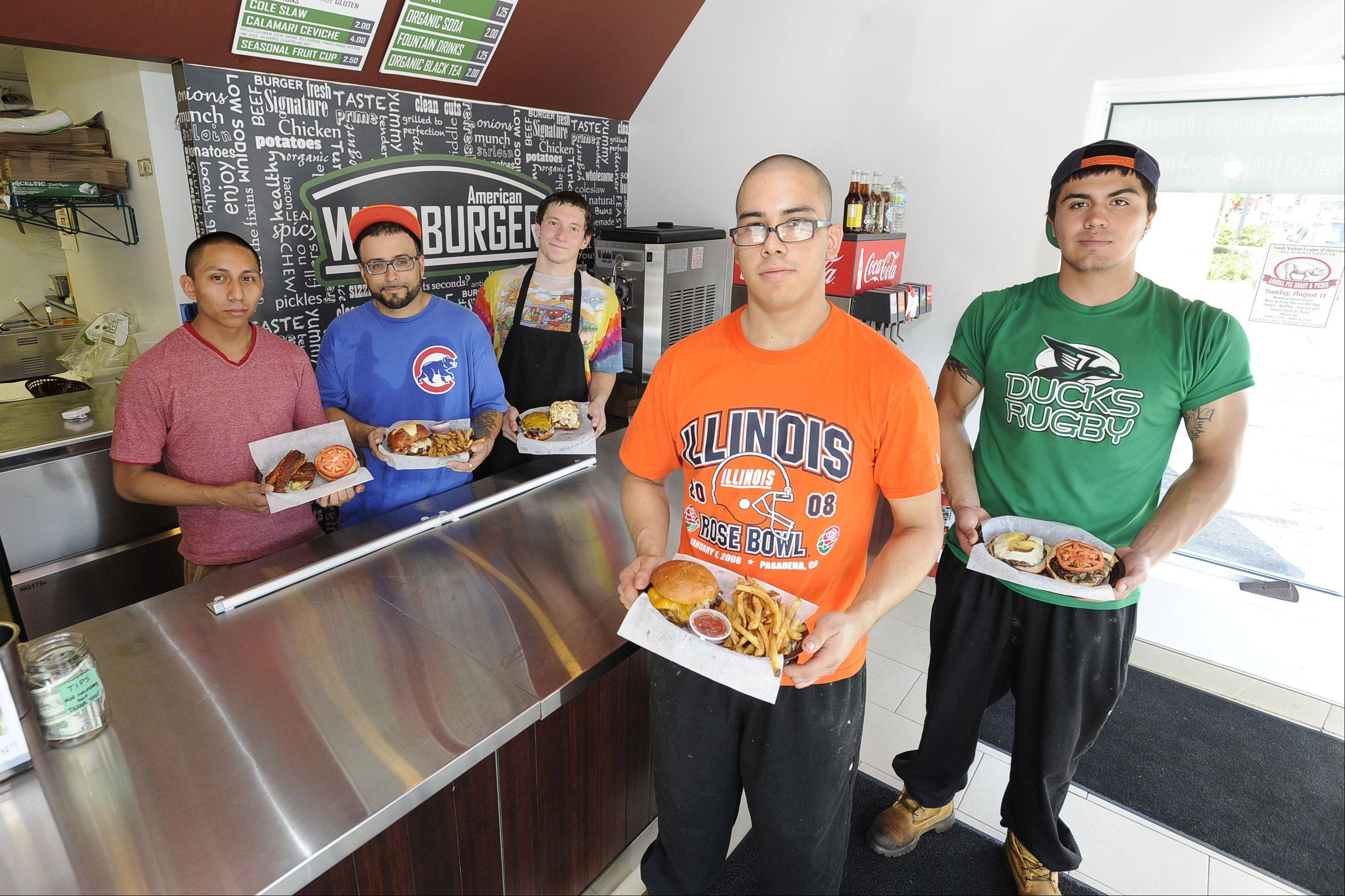 The American Wildburger staff, including manager Antonio Talavera, front, left, and Hugo Dacensio along with Chuy Ramirez, back row from left, Nino Valerio and Dominic Karpinski, flip the burgers at the Oakton Avenue eatery.