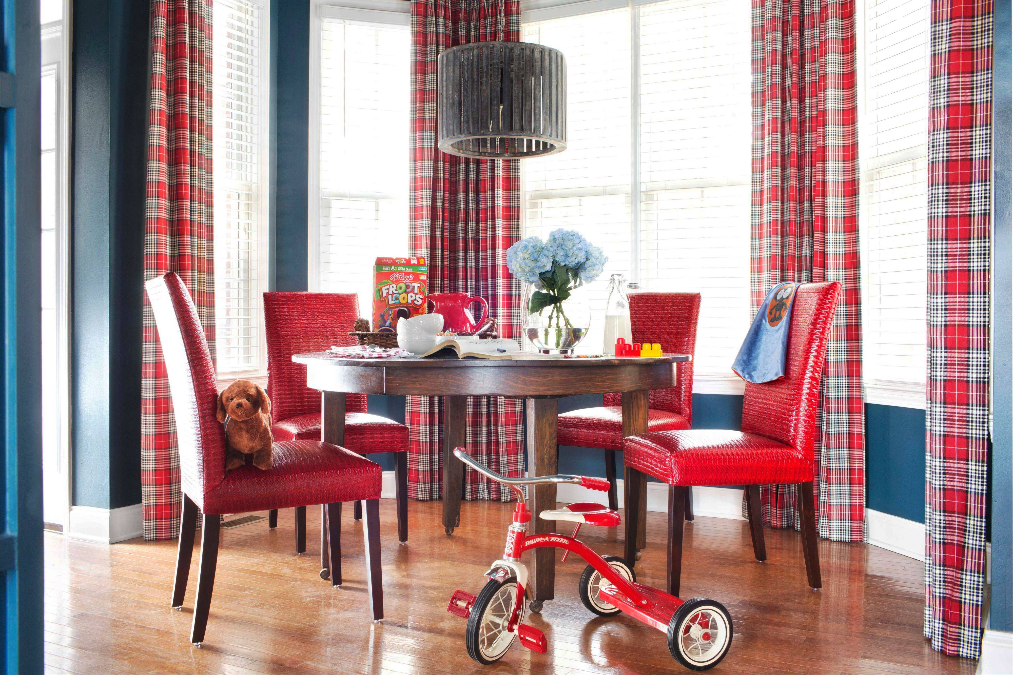 To create a family-friendly breakfast nook, designer Brian Patrick Flynn mixes classic patterns such as plaid, youthful colors such as navy blue and red, commercial-grade fabrics like automotive vinyl and tables with rounded corners to avoid any mishaps from roughhousing.