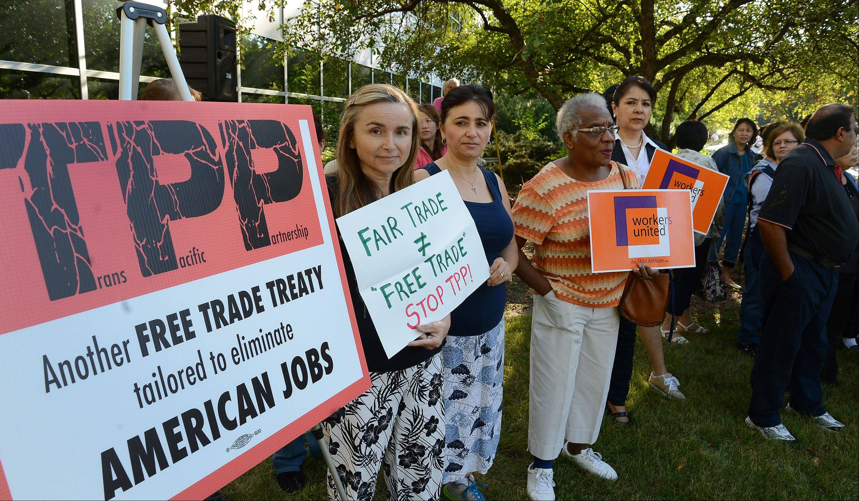 Workers rallied Wednesday in front of the Hart Schaffner & Marx factory in Des Plaines to protest the proposed Trans-Pacific Partnership free trade agreement they say would impact textile and apparel manufacturing jobs.