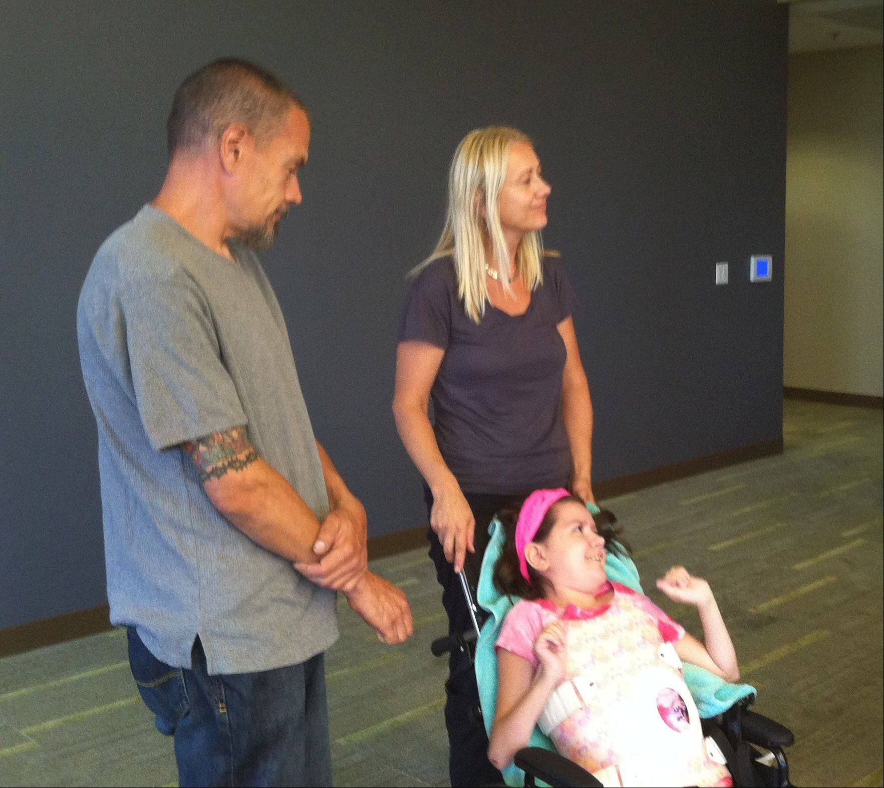 The Wheeling Village Board honored Peter and Tania Alt and their daughter, Emma, this week.