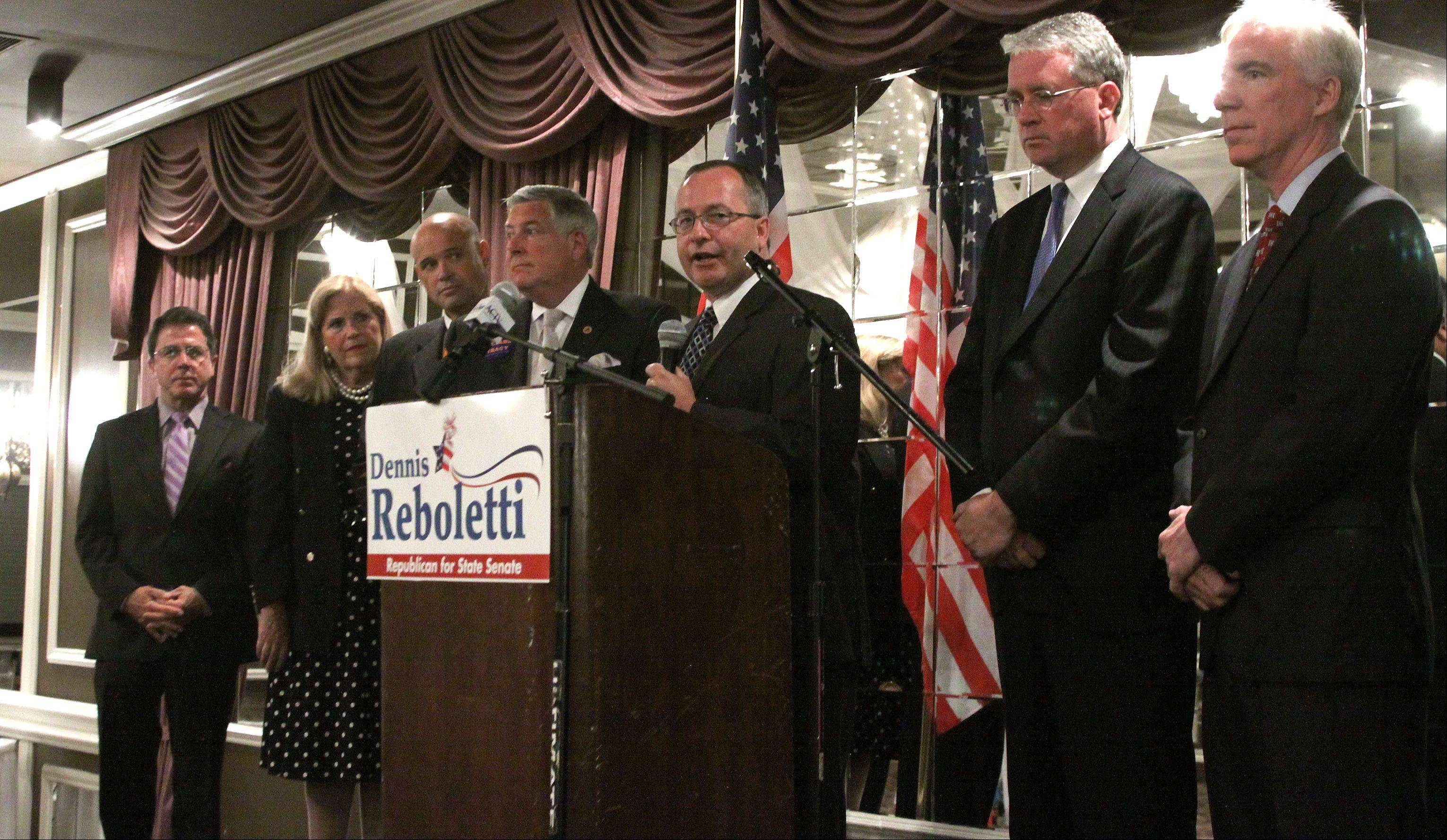 State Rep. Dennis Reboletti of Elmhurst, center, announced Wednesday that he's seeking an Illinois Senate seat.