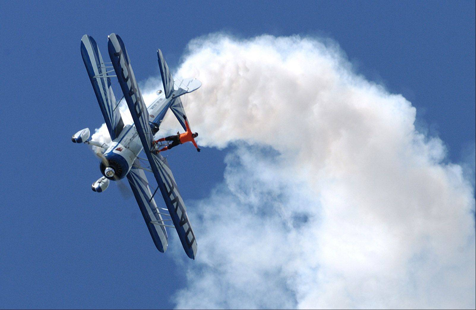 Wingwalker Tony Kazian of Dave Dacy Airshows during last year's Waukegan Air Show.