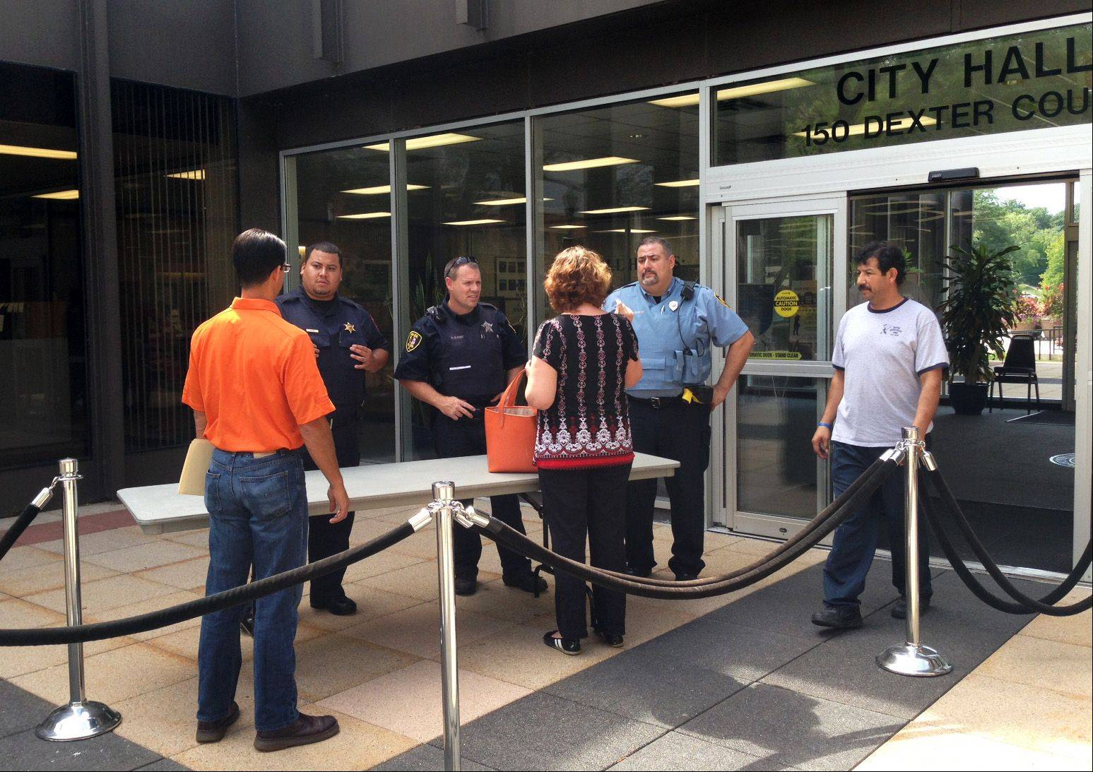 The Elgin branch court reopened by 1 p.m. Wednesday after a bomb threat earlier in the day. Elgin police set up a bag check for the rest of the day outside city hall, where the court is located.