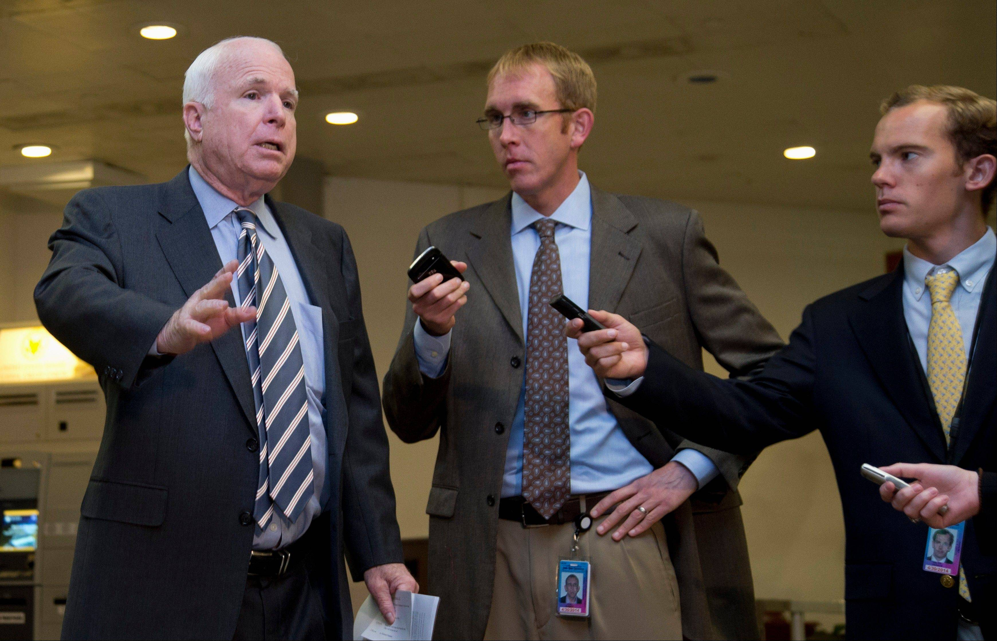 Foreign Relations Committee member Sen. John McCain, R-Ariz., talks with reporters on Capitol Hill in Washington, Wednesday, Sept. 4, 2013, as he walks to a closed-door committee meeting on the authorization of the use of force in Syria.