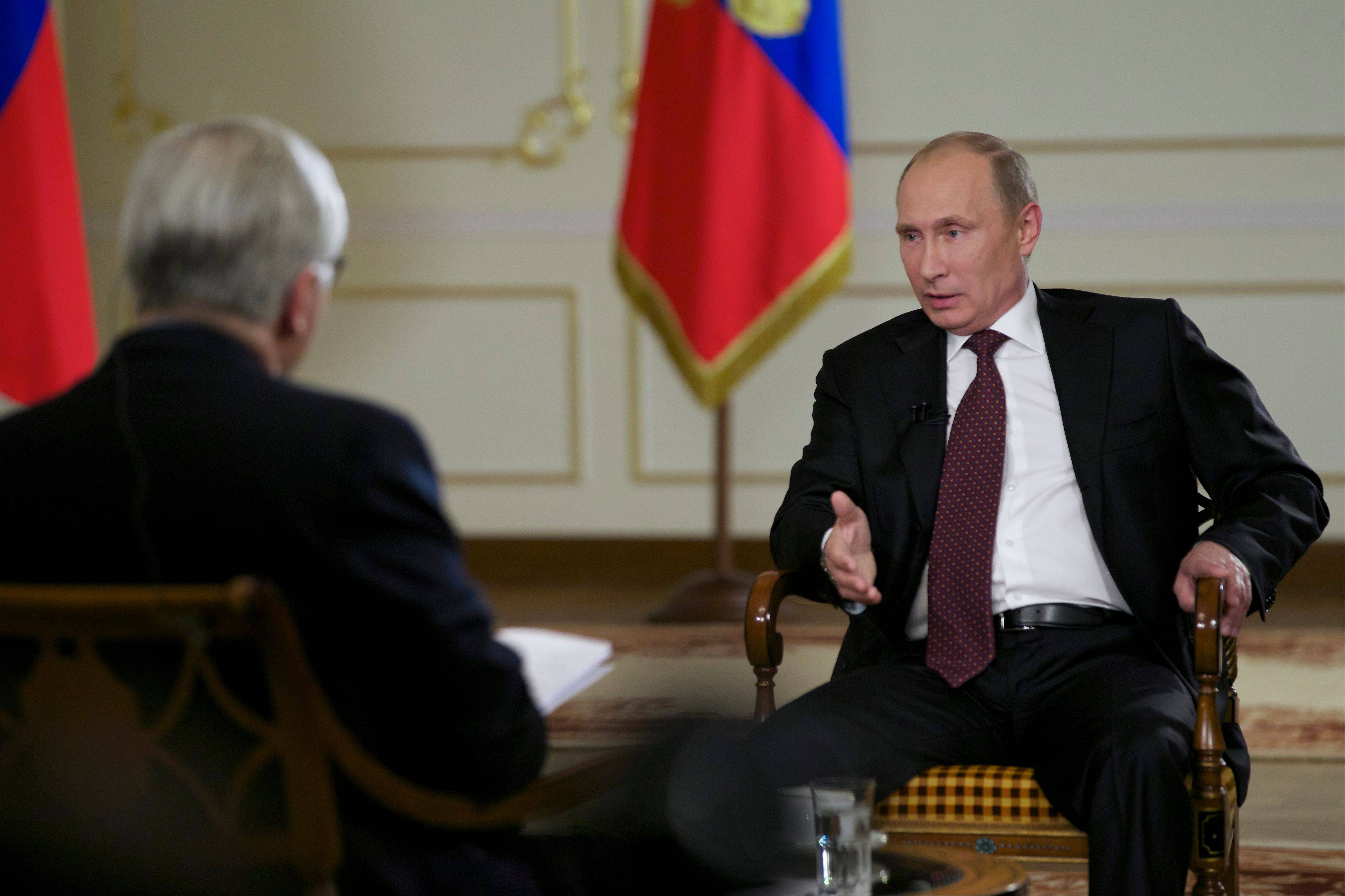 Russian President Vladimir Putin, right, speaks to John Daniszewski, the Associated Press's Senior Managing Editor for International News, during an AP interview at Putin's Novo-Ogaryovo residence outside Moscow, Russia, Tuesday, Sept. 3, 2013. Putin sought to downplay the current chill in the U.S.-Russian relations and said that the two countries need to cooperate on a range of issues in the interests of global stability.