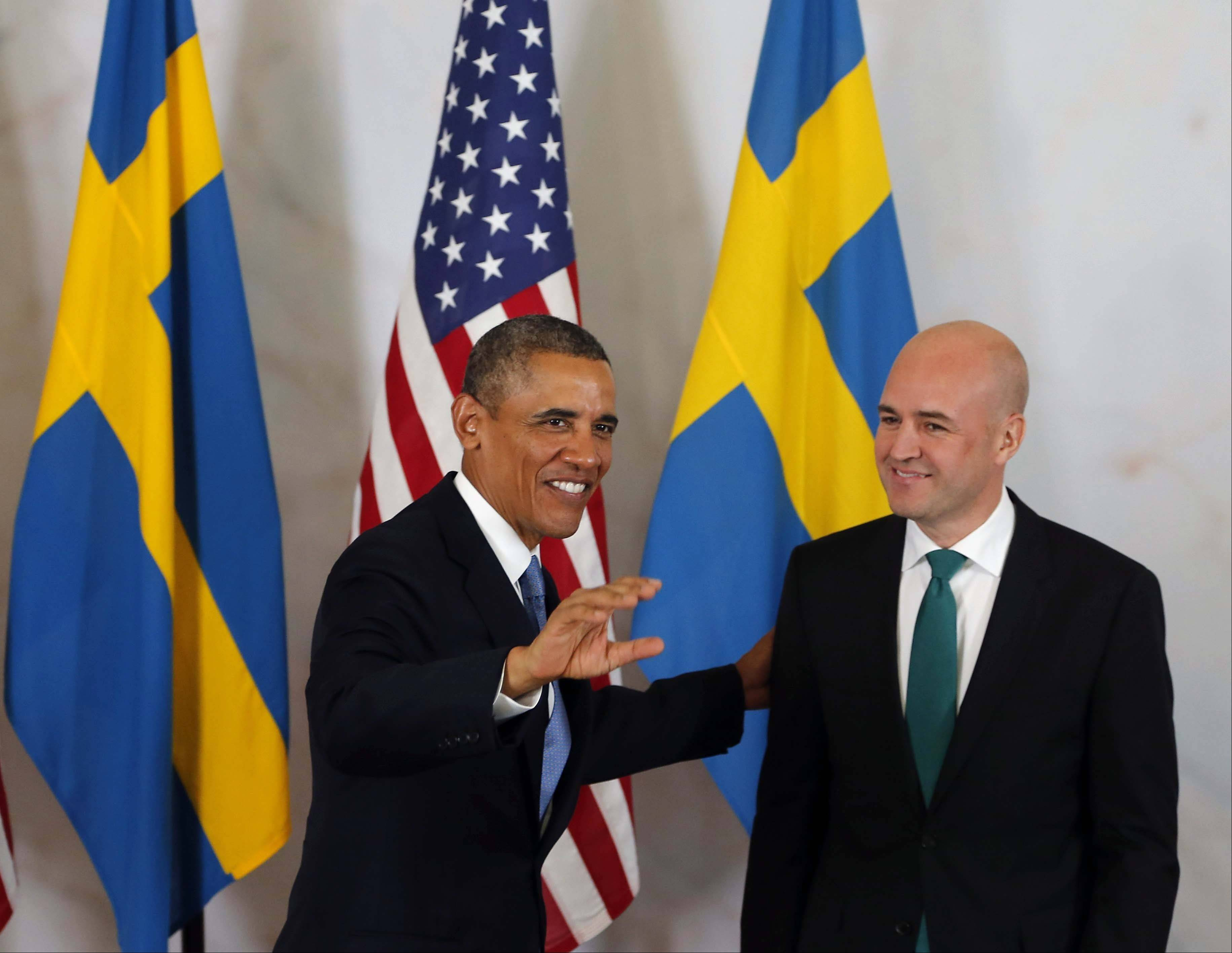 President Barack Obama, left, meets Wednesday with Sweden's Prime Minister Fredrik Reinfeldt at Rosenbad, the seat of the Swedish government in Stockholm, Sweden. President Barack Obama is opening a three-day overseas trip with a stop in Stockholm, ahead of the G-20 Summit in St. Petersburg, Russia.