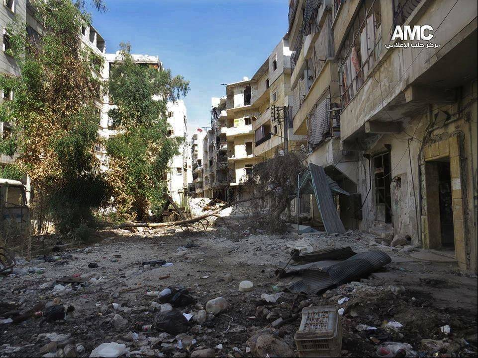 This citizen journalism image provided by Aleppo Media Center AMC which has been authenticated based on its contents and other AP reporting, shows damaged residential buildings Tuesday due to clashes between Free Syrian army fighters and government forces in Aleppo, Syria.