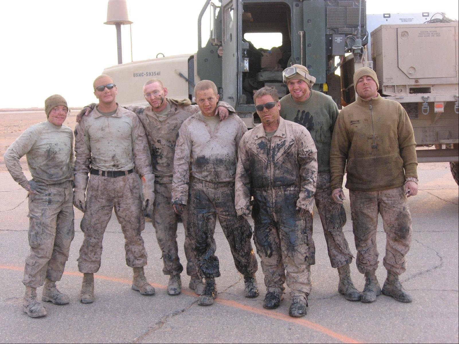 Hoffman Estates native Justin Sher, second from left, and his fellow Marines get dirty repairing broken runways to be combat-ready in northern Iraq. The mission was in a desolate area with no showers and few supplies, so the group brought with them items they received in care packages from the Yellow Ribbon Support Group.