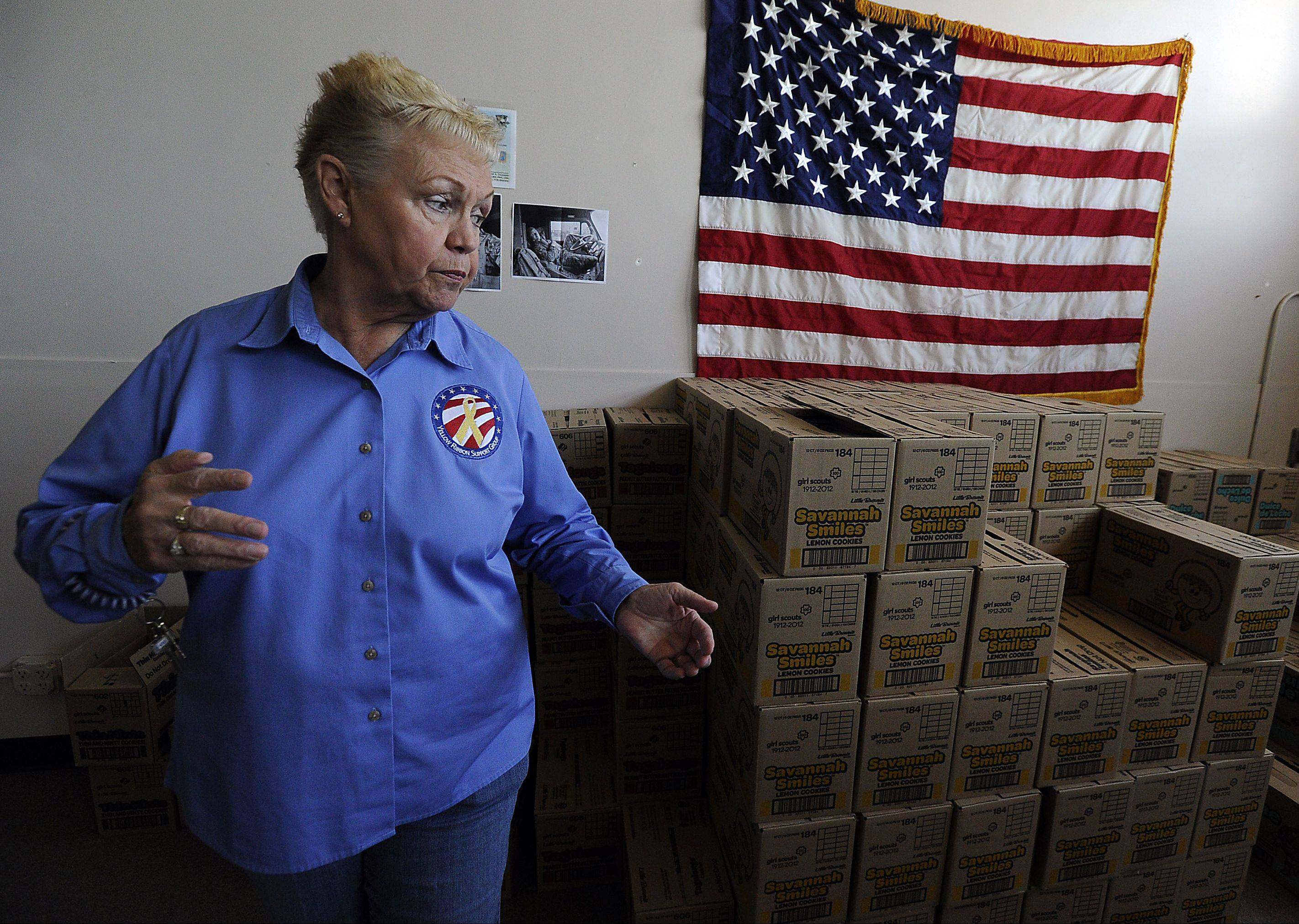 Yellow Ribbon Support Group co-founder Pat McCoy of Palatine looks over the remaining supply of Girl Scout cookies donated for troops overseas. She and husband Mac McCoy are shutting down the nonprofit organization after more than 10 years.