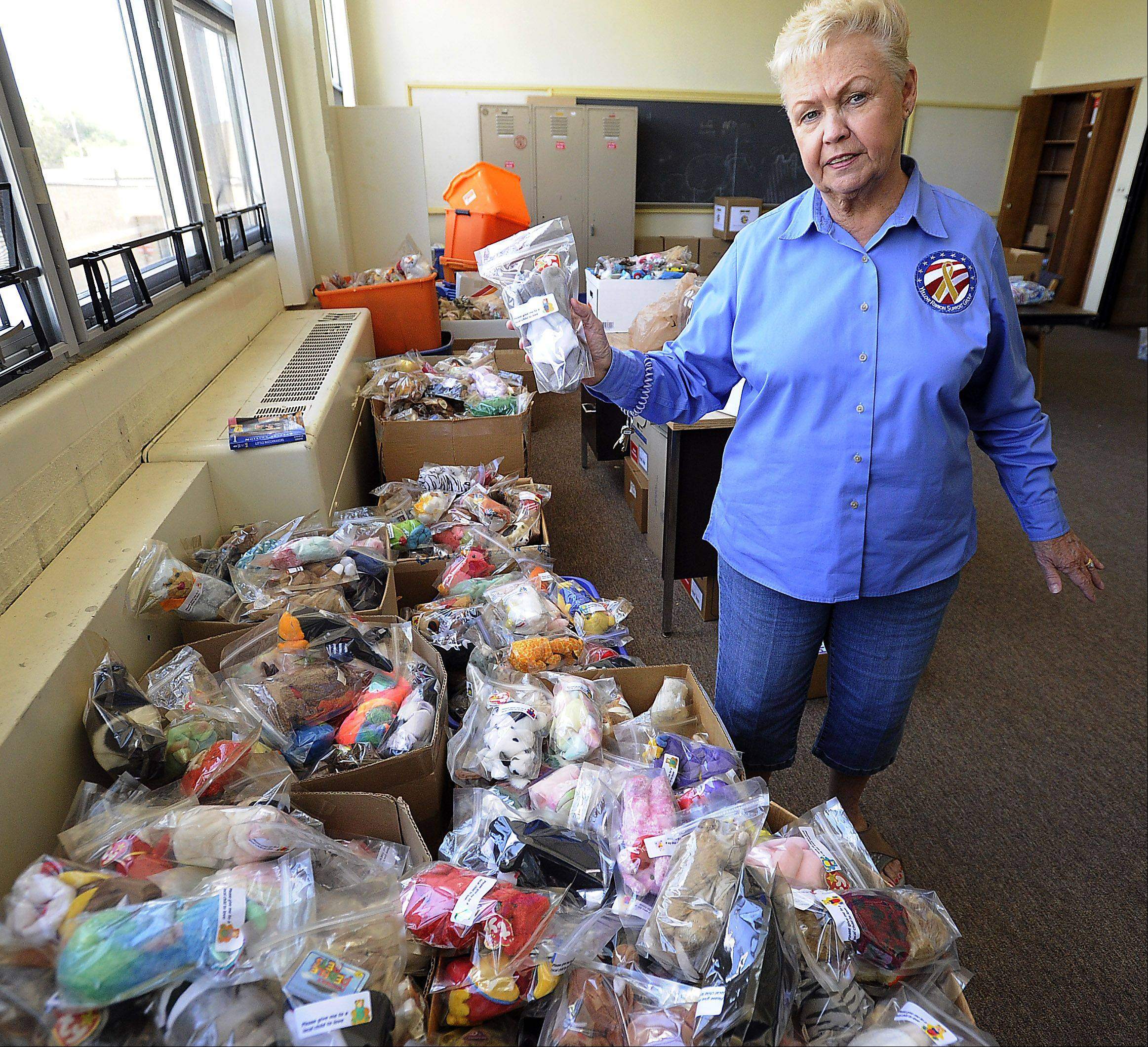Yellow Ribbon Support Group co-founder Pat McCoy of Palatine sorts through the remaining supply of Beanie Babies that have been sent to American troops who give them to children they encounter overseas. She and husband Mac McCoy are shutting down the nonprofit organization after more than 10 years.