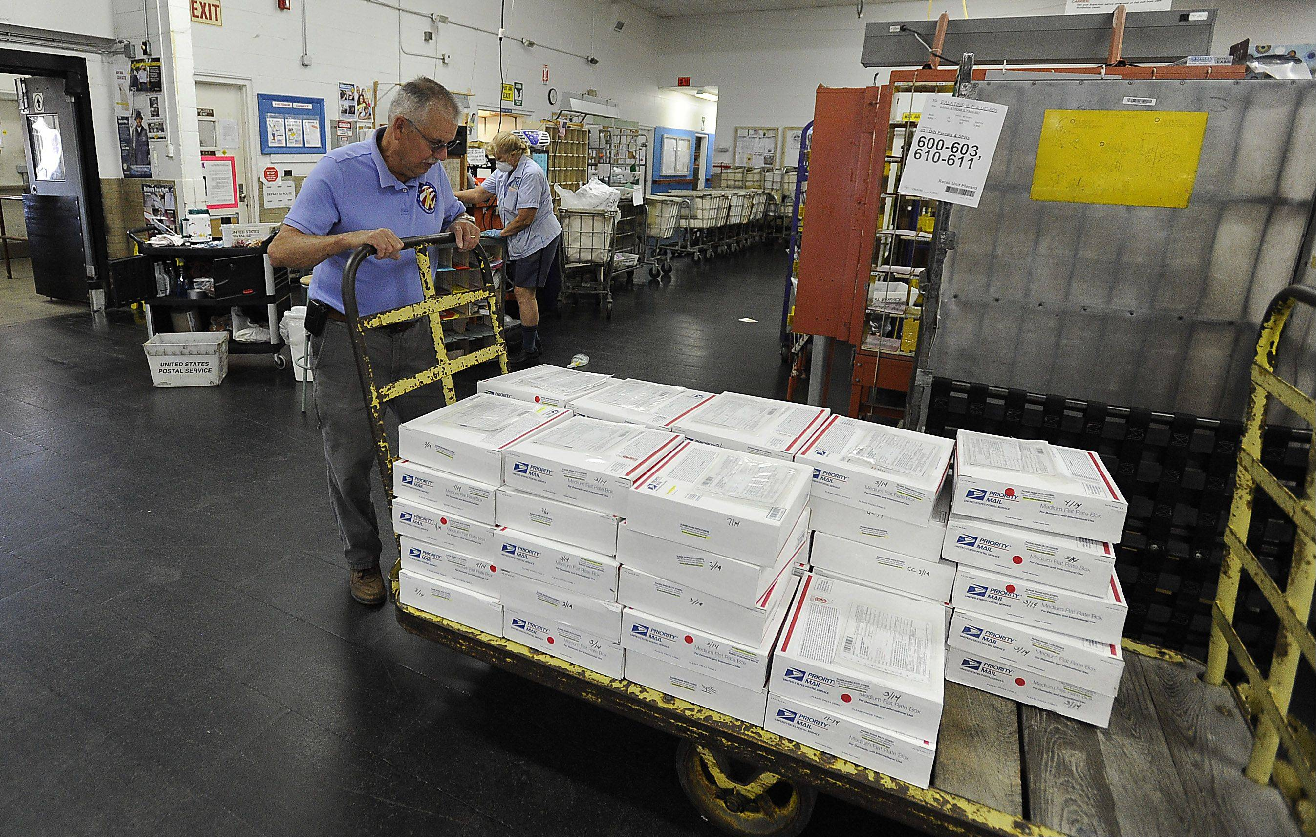 Yellow Ribbon Support Group co-founder Mac McCoy unloads care packages at the Palatine post office to be shipped to troops in Afghanistan.