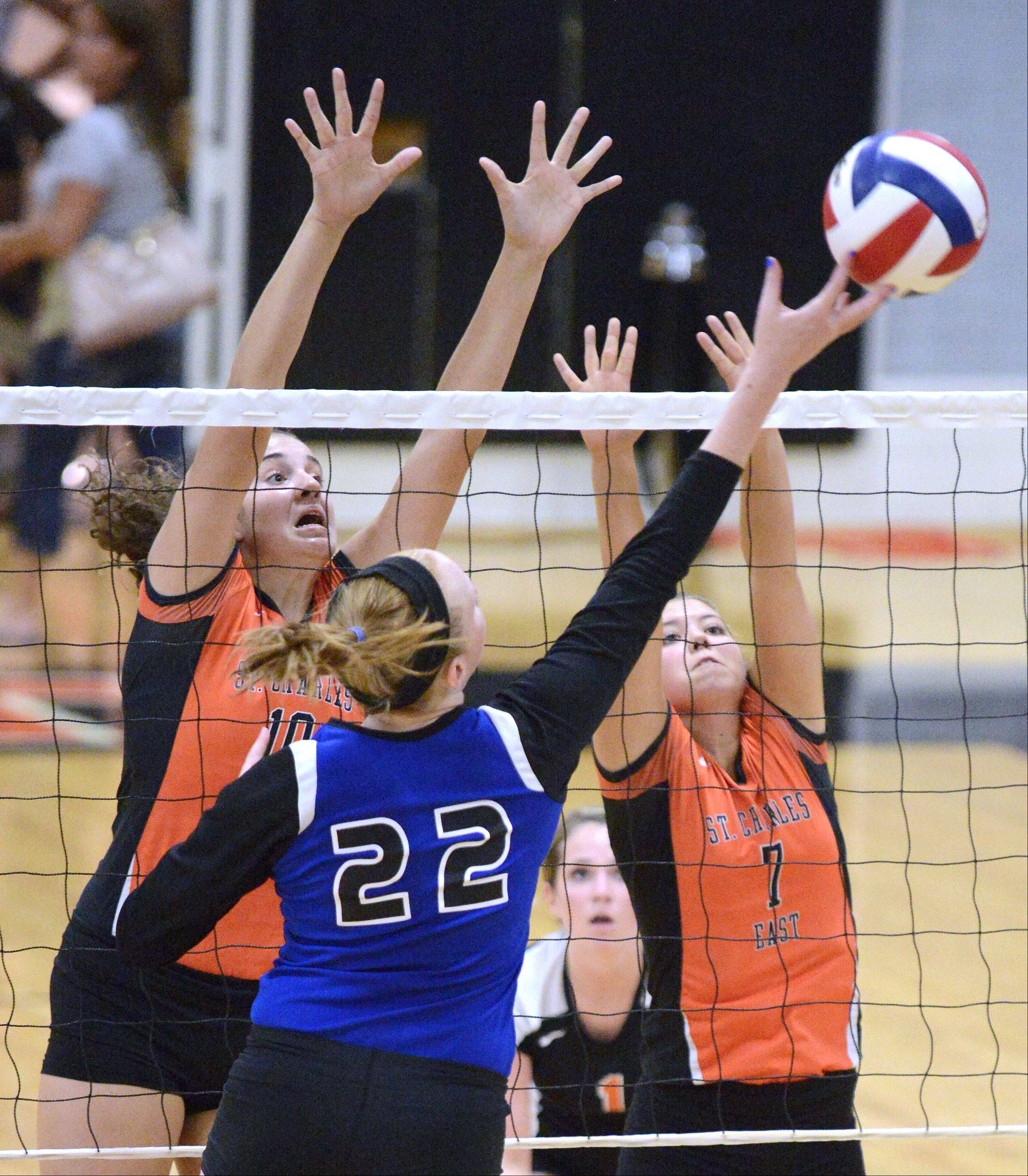 St. Charles East's Mikaela Mosquera and Meagan Smith block a tip of the ball over the net by Rosary's Joanna Wedge in the second game on Wednesday, September 4.