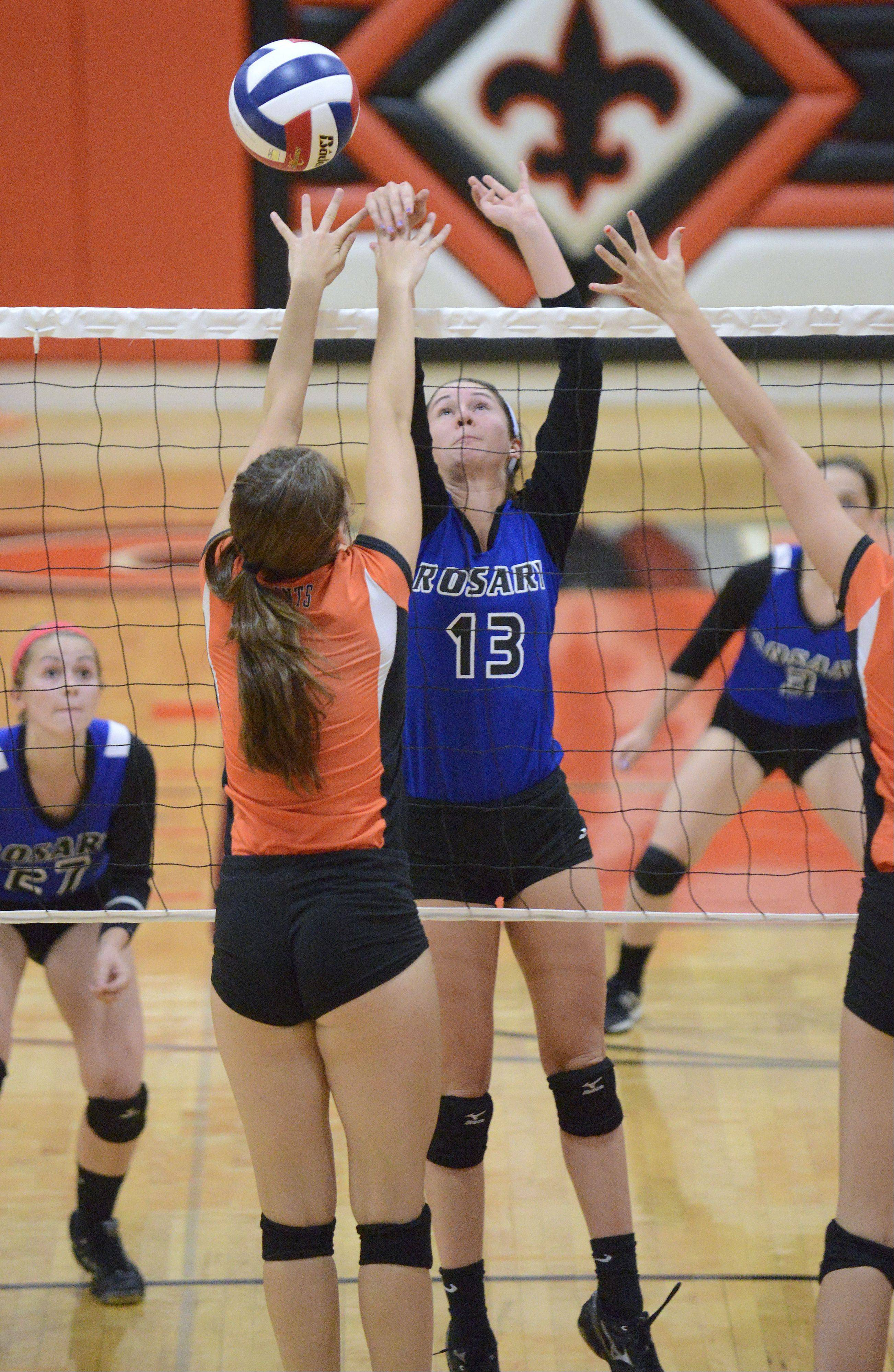 Rosary's Josephine Gallagher sends the ball over to St. Charles East's Ally Watson in the first game on Wednesday, September 4.