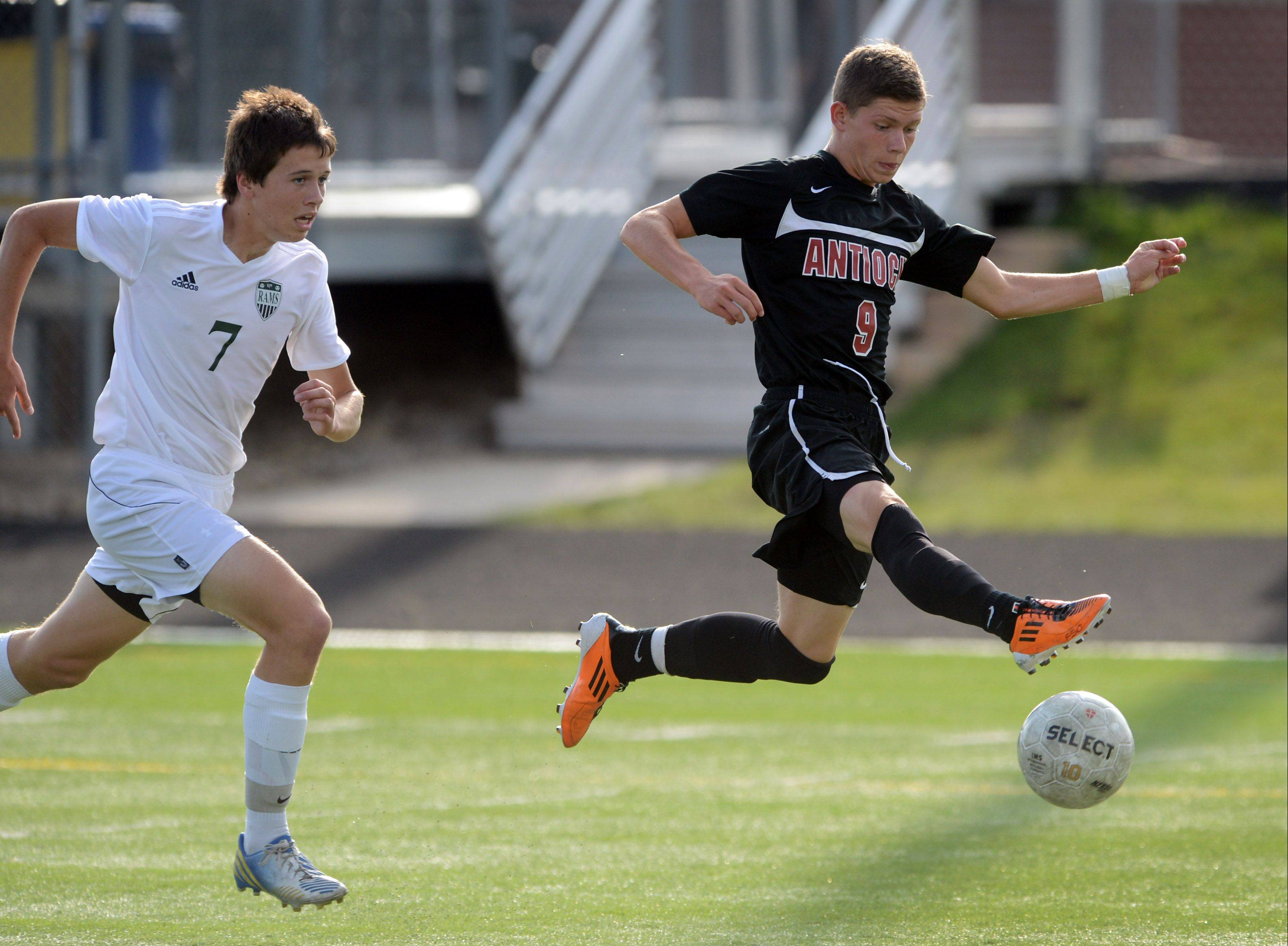 Antioch's Krystian Streit controls the ball as Grayslake Central's John Moroney gives chase during Wednesday's match in Grayslake.