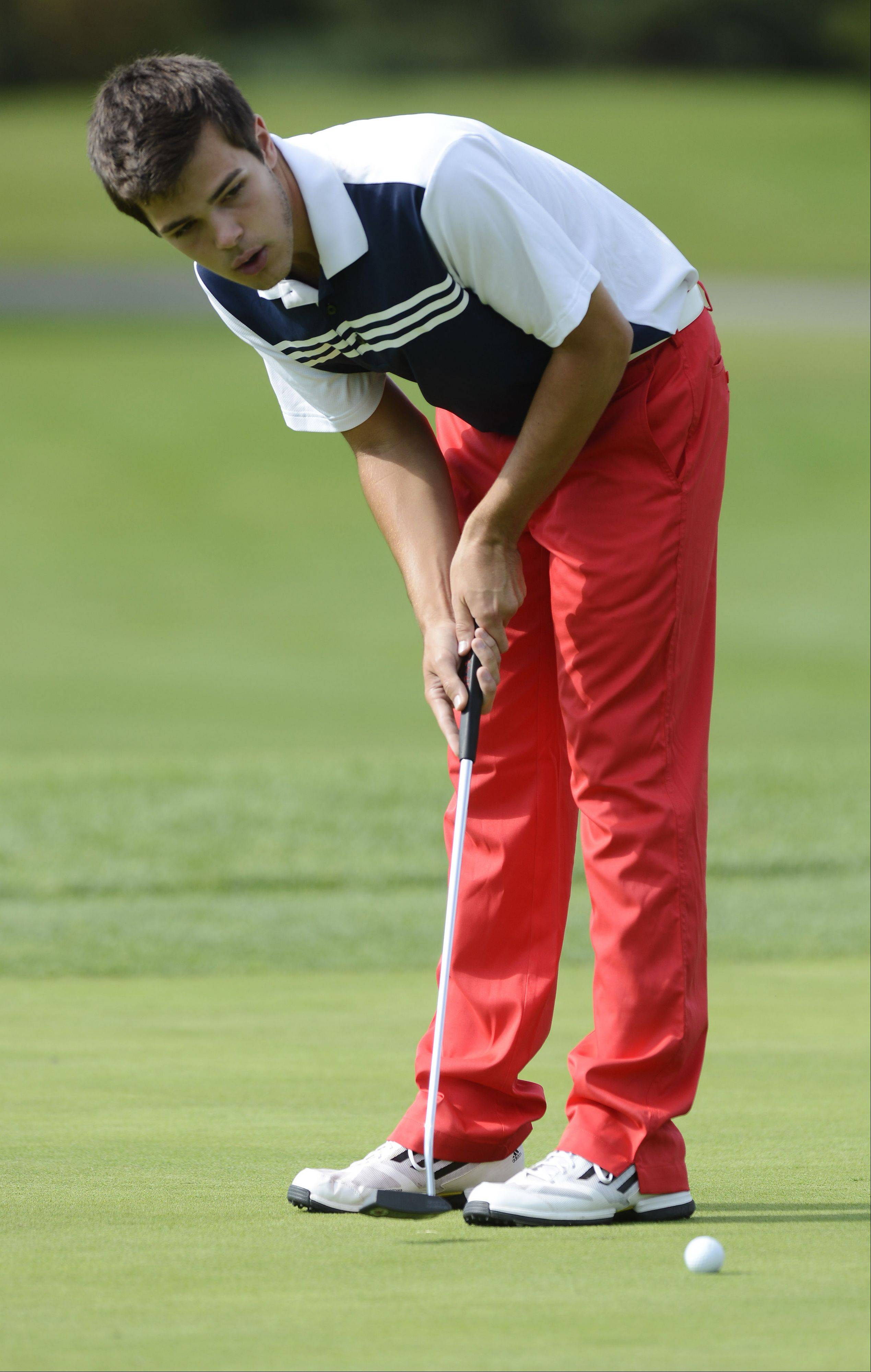 Conant's Michael Mayer putts during Wednesday's match with Palatine and Prospect at Palatine Hills Golf Course.