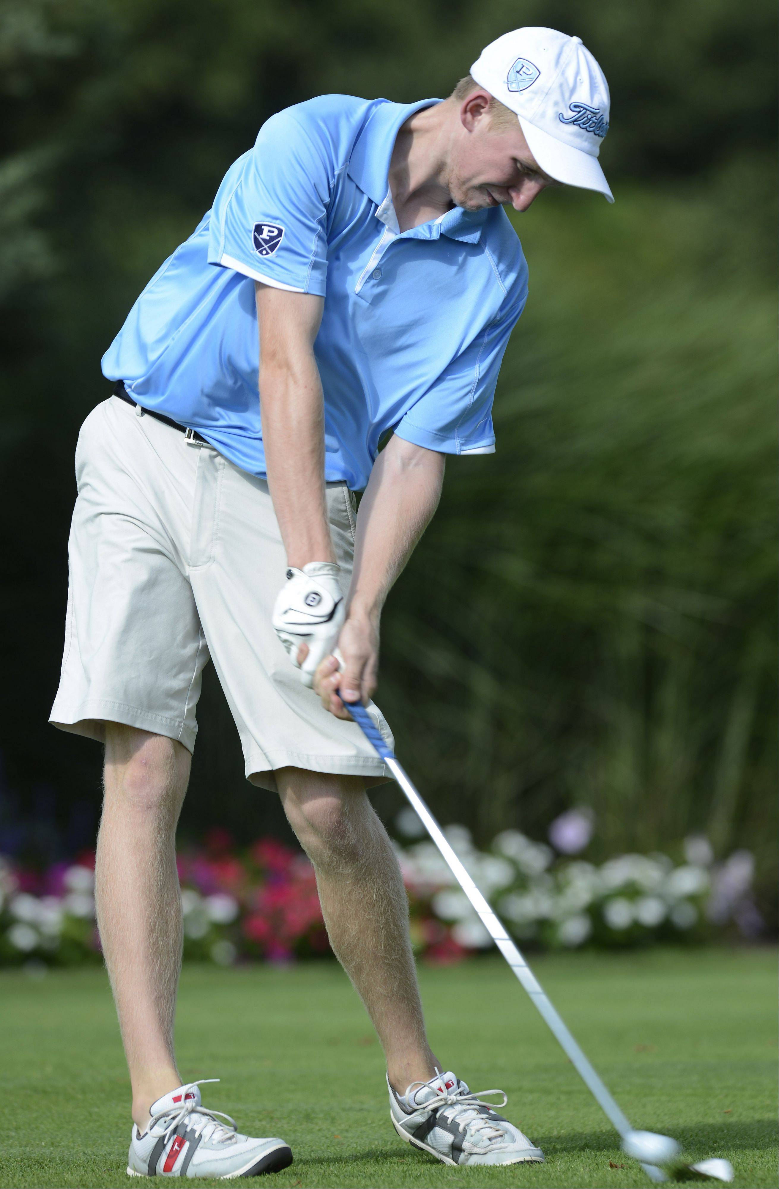 Prospect's Reid Dahlstrom tees off on No. 2 at Palatine Hills on Wednesday.