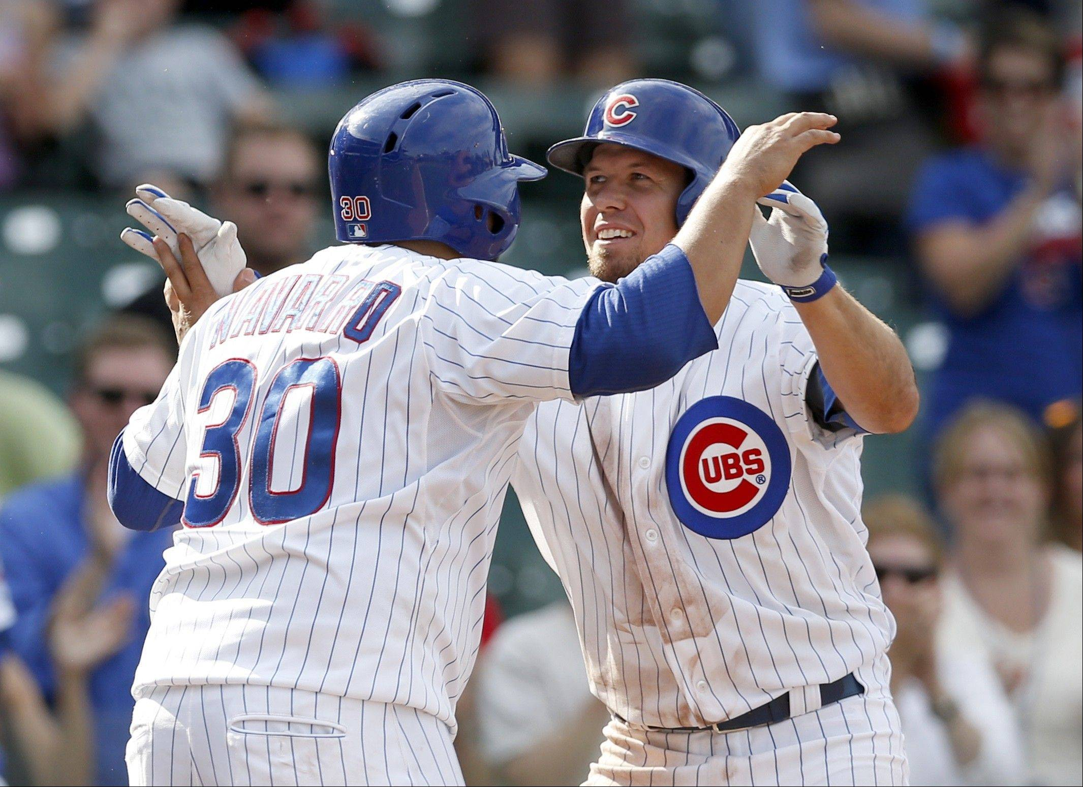 The Cubs' Dioner Navarro (30) and Donnie Murphy celebrate after the pair scored on Murphy's home run off Miami Marlins relief pitcher Ryan Webb during the seventh inning of a baseball game Wednesday, Sept. 4, 2013, in Chicago.