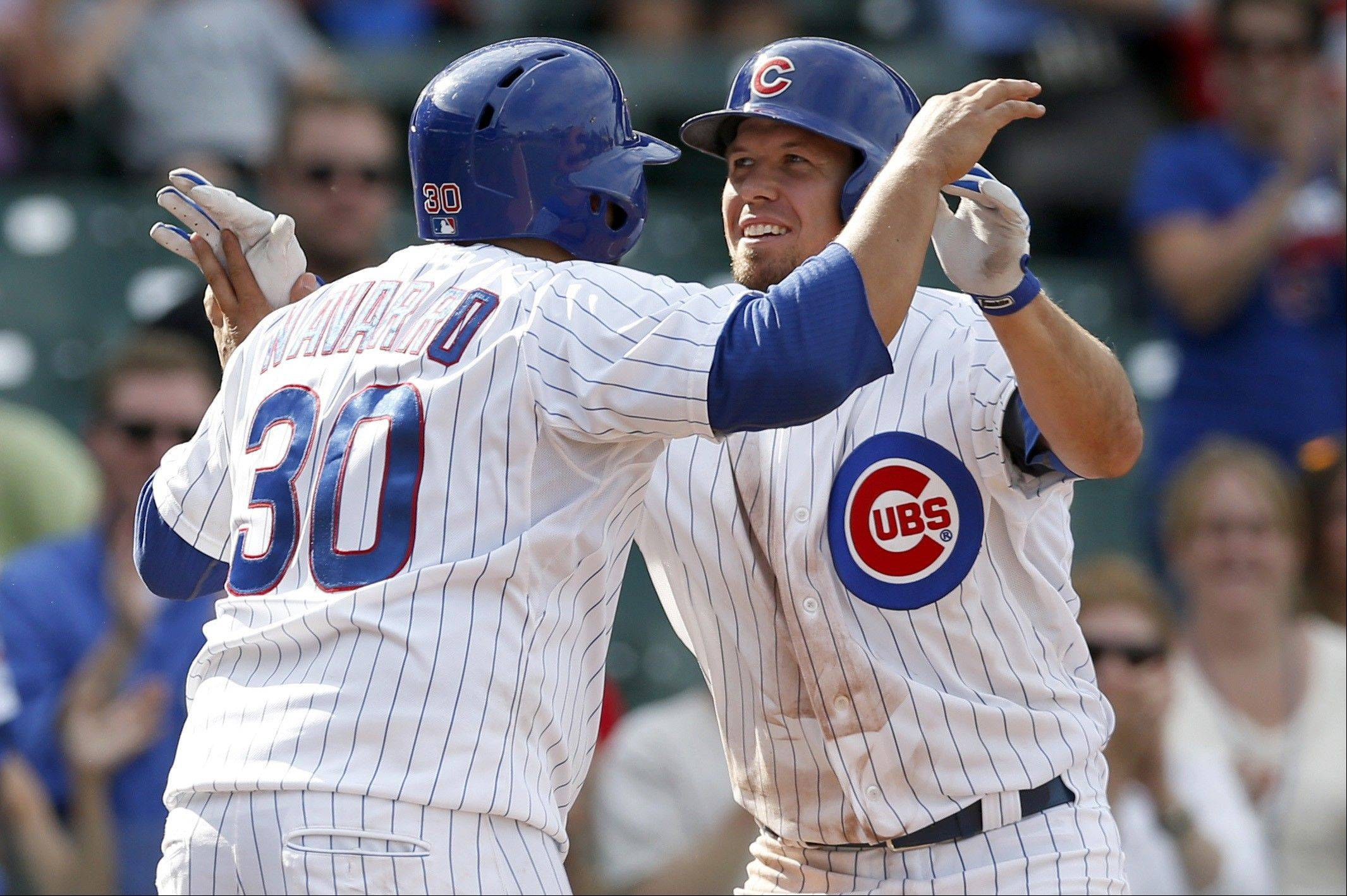 The Cubs' Dioner Navarro (30) and Donnie Murphy celebrate after the pair scored on Murphy's home run hit off Miami Marlins relief pitcher Ryan Webb during Wednesday's game at Wrigley Field.