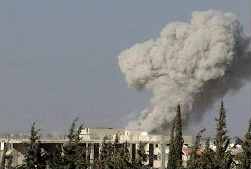 In this citizen journalism image provided Wednesday by Edlib News Network, ENN, which has been authenticated based on its contents and other AP reporting, smoke rises from buildings due to an airstrike that hit Sarakeb, Idlib province, Syria.