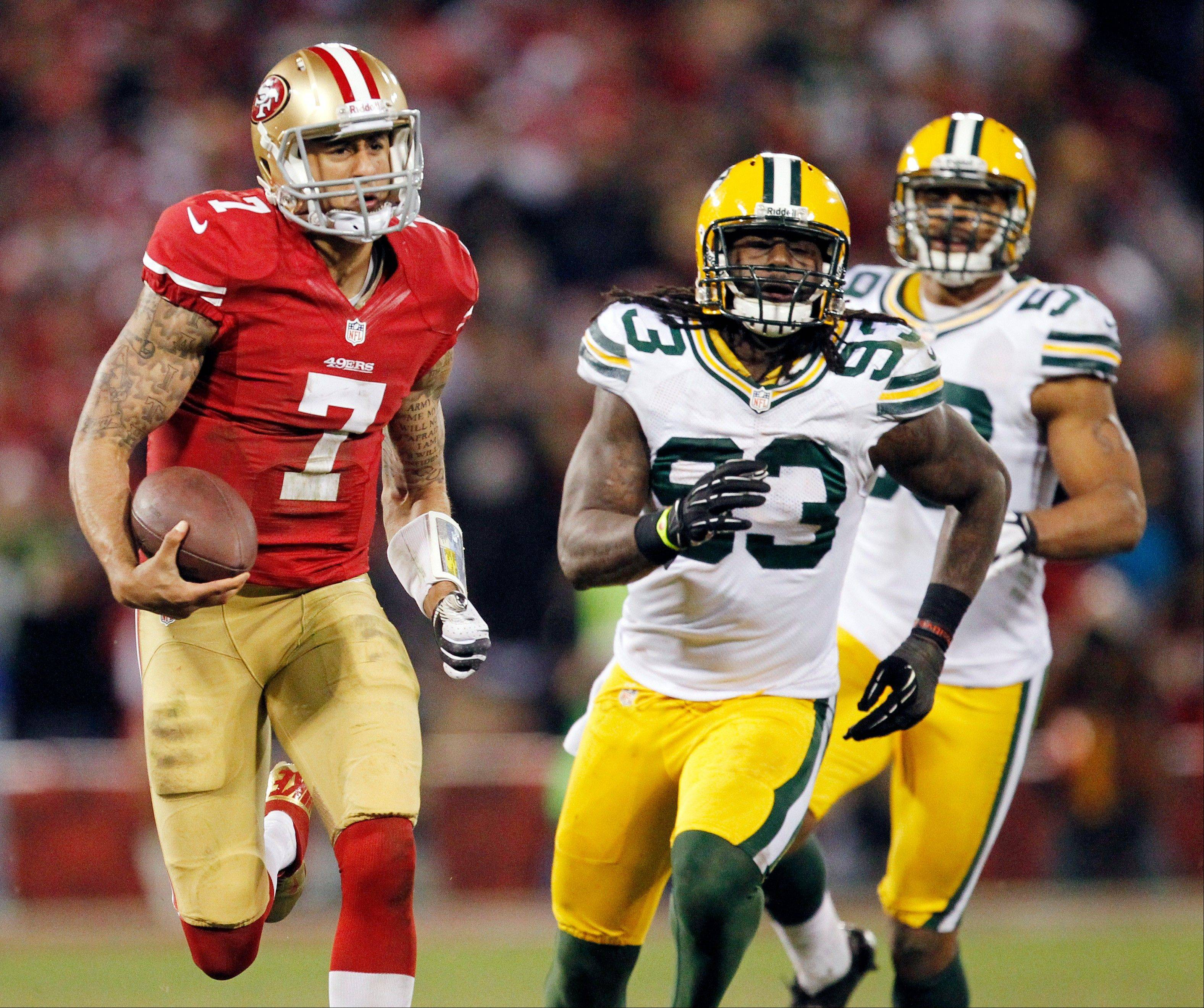 ADVANCE FOR WEEKEND EDITIONS, SEPT. 7-8 - FILE - In this Jan. 12, 2013, file photo, San Francisco 49ers quarterback Colin Kaepernick (7) runs for a 56-yard touchdown past Green Bay Packers outside linebacker Erik Walden (93) and inside linebacker Brad Jones (59) during the third quarter of an NFC divisional playoff NFL football game in San Francisco. The last time the Packers saw Kaepernick in person, he was a meteor tearing through their flimsy defense. When Green Bay journeys to San Francisco for Sunday's marquee matchup with the NFC champion 49ers, that defense better be a lot stingier, or the Packers will get smashed up again. (AP Photo/Tony Avelar, File)
