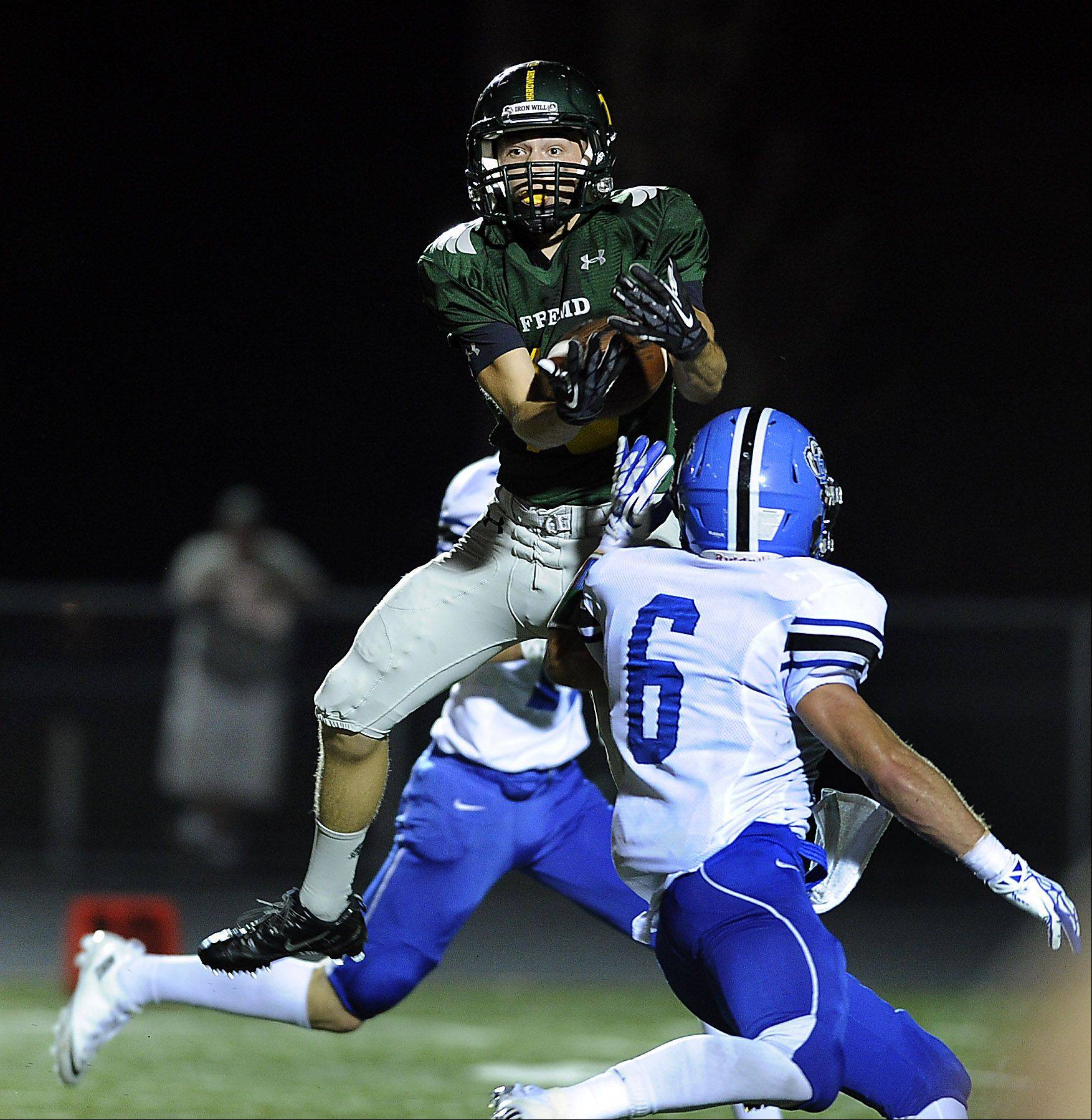 Fremd�s Anthony Halvorsen hauls in a pass play in the first quarter last weekend as Lake Zurich�s Sean Lynch attempts to stop him. The Vikings were held to 66 yards rushing and 62 passing as LZ won 24-0.