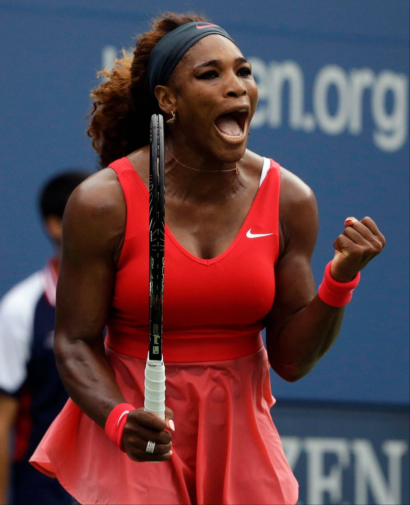 Serena Williams reacts after a point against Sloane Stephens during the fourth round of the 2013 U.S. Open tennis tournament, Sunday, Sept. 1, 2013, in New York. (AP Photo/David Goldman)