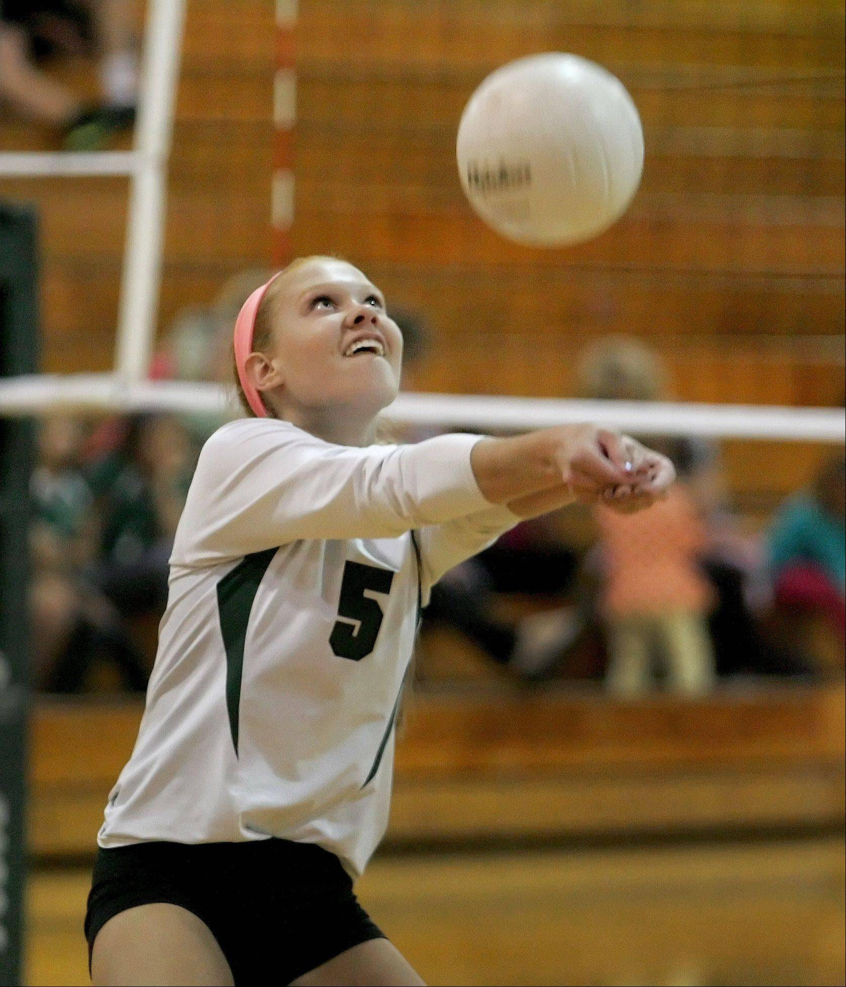 Bev Horne/bhorne@dailyherald.com � Meg DeMaar of Glenbard West bumbs the ball over in in girls volleyball action against Willowbrook on Monday in Glen Ellyn.