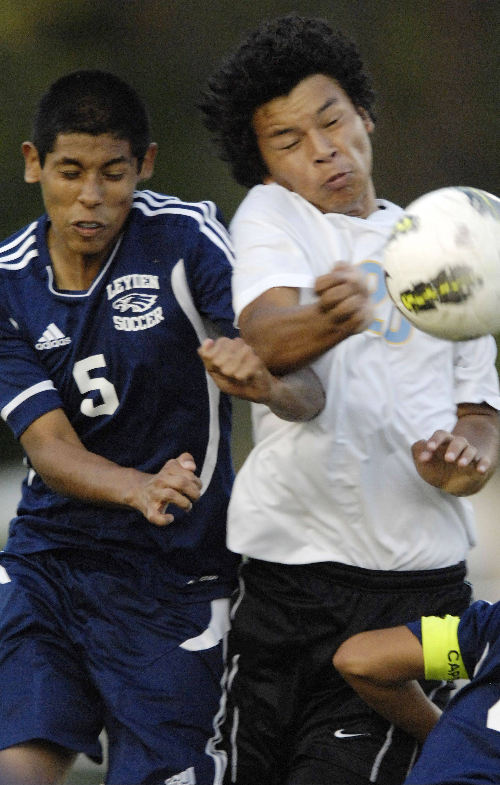 Maine West�s Nelson Herrera, at right, vying for possession with Leyden�s Moises Merlos last season, is a two-time all-area team selection with 56 goals entering his senior season.