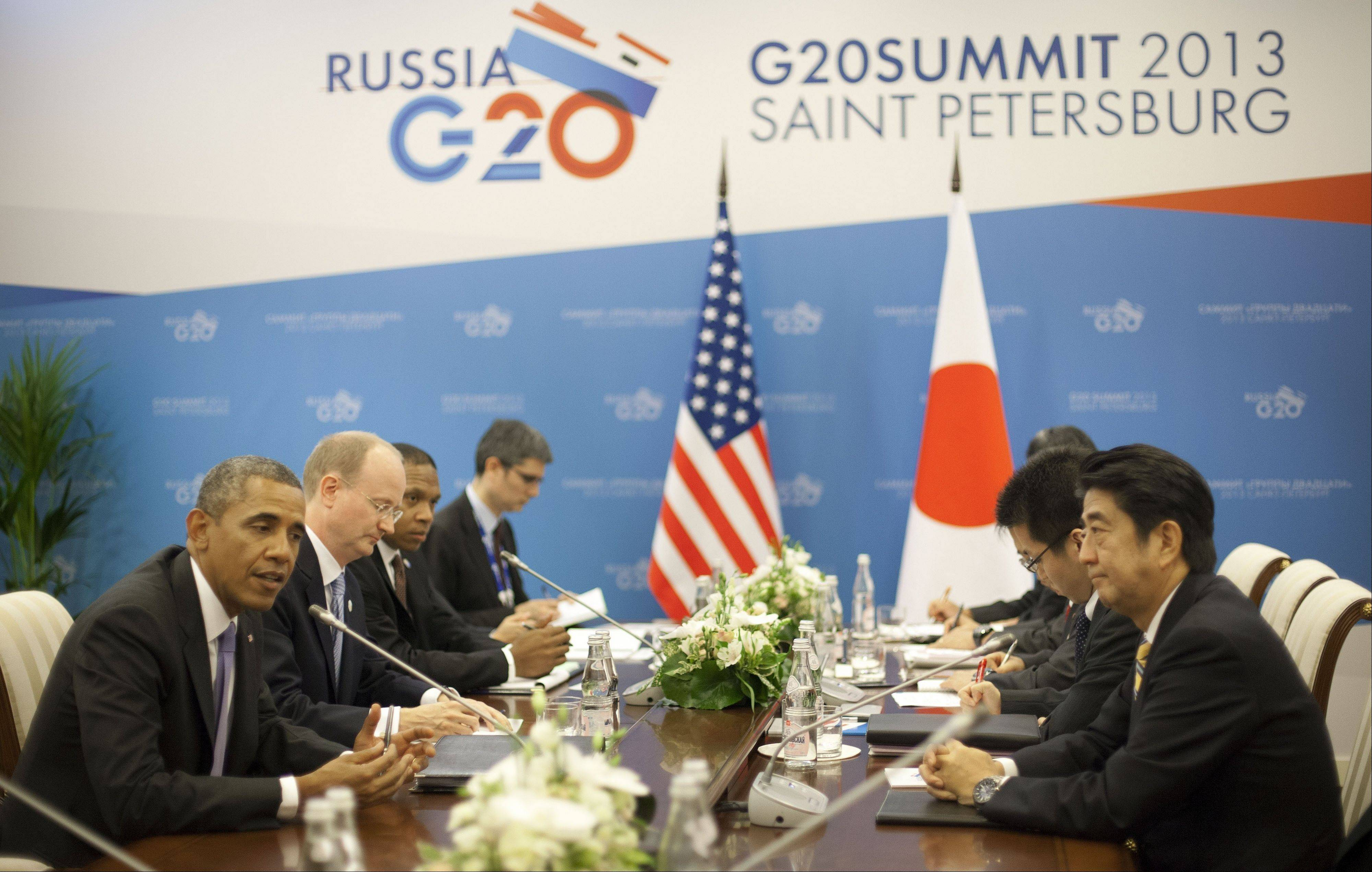 U.S. President Barack Obama, left, and Japan's Prime Minister Shinzo Abe, right, Thursday during their bilateral meeting at the G-020 Summit in St. Petersburg, Russia.