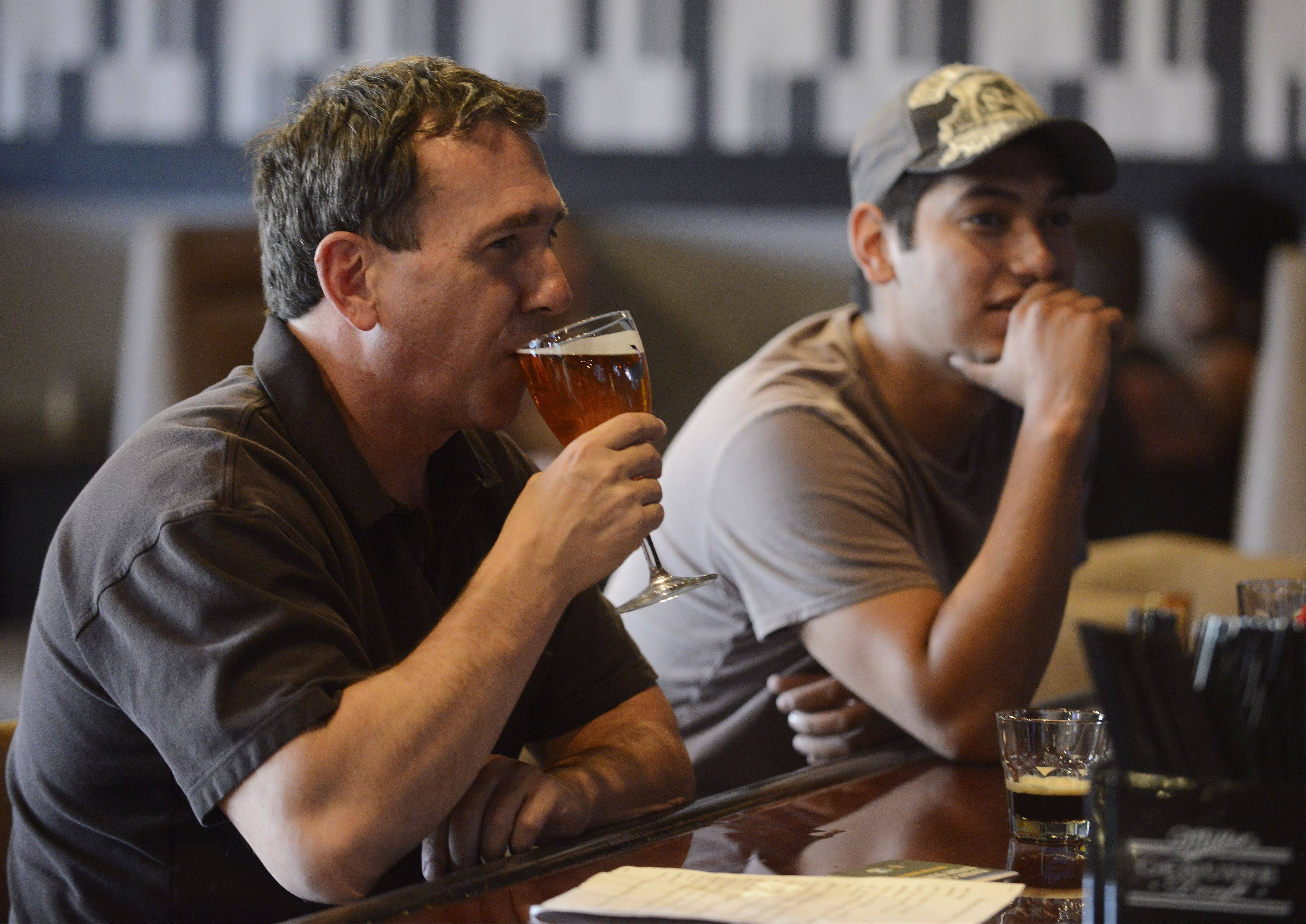 Steve Fink, left, has a beer at Schaumburg Ale House with his brother, Edward. Both are from Hoffman Estates.