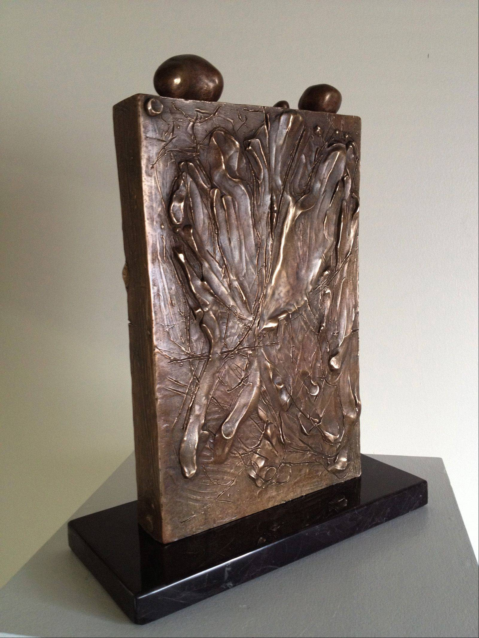 """Prayer Memorial for the Souls of Terezin,"" bronze, by Geneva sculptor Larry Johnson."