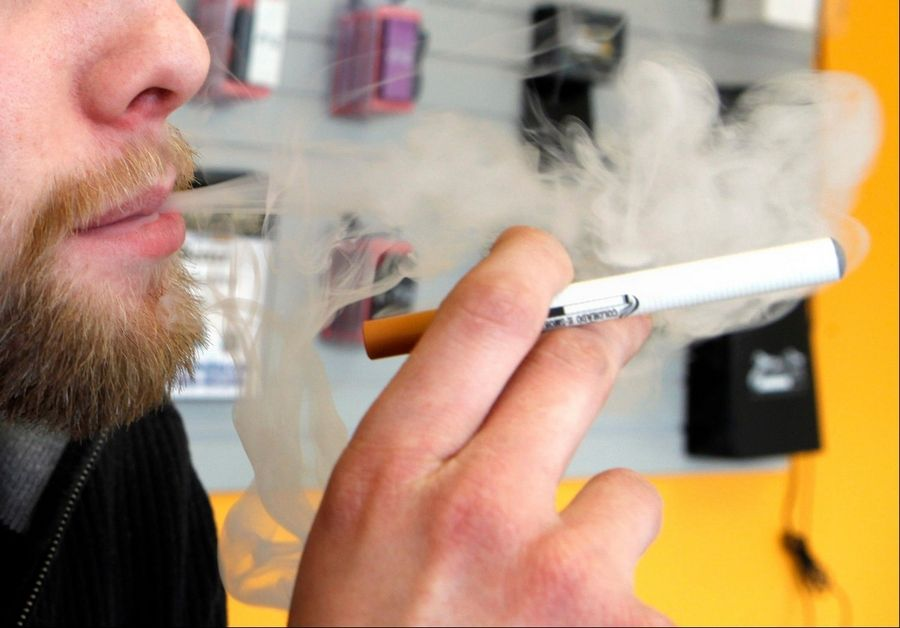 ASSOCIATED PRESSA sales associate demonstrates the use of a electronic cigarette and the smoke-like vapor that comes from it in Aurora, Colo., this week.