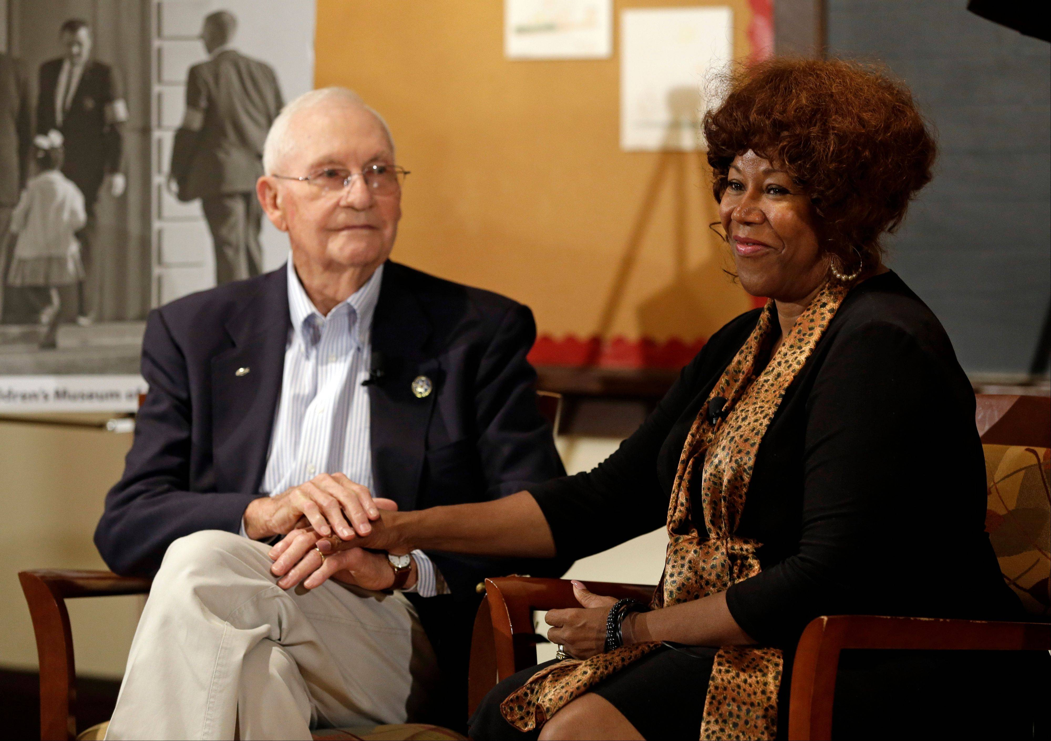Ruby Bridges, right, who integrated Louisiana schools in 1960 under escort from U.S. Marshals, meets with Charles Burks, 91, who was one of those marshals. The two filmed a video Thursday to share their experience with children.