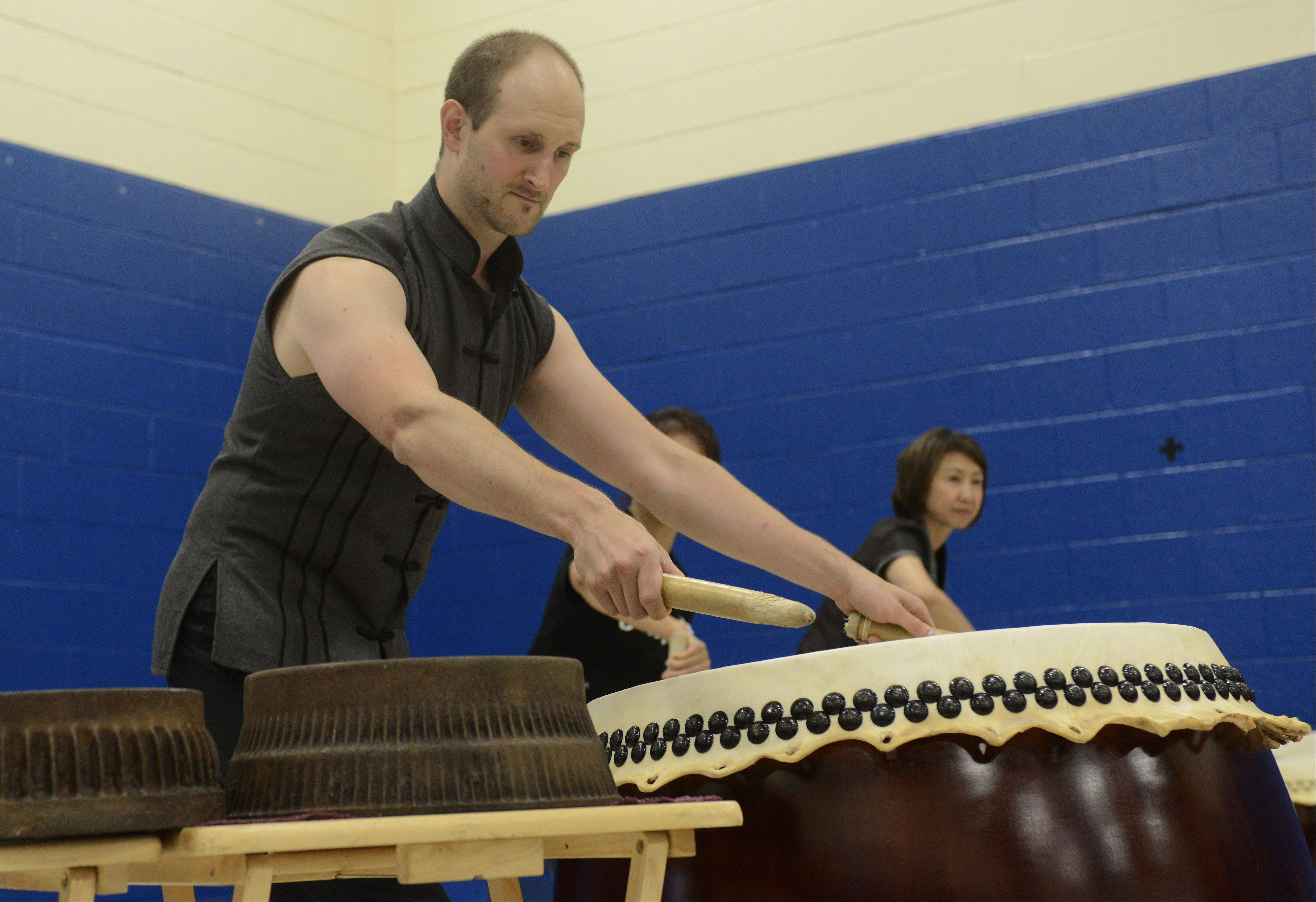 Brent Roman of the Cheng Da Drum Team plays Chinese drums which were donated Thursday to Campanelli School in Schaumburg by the Taiwanese Overseas Compatriot Affairs Council.