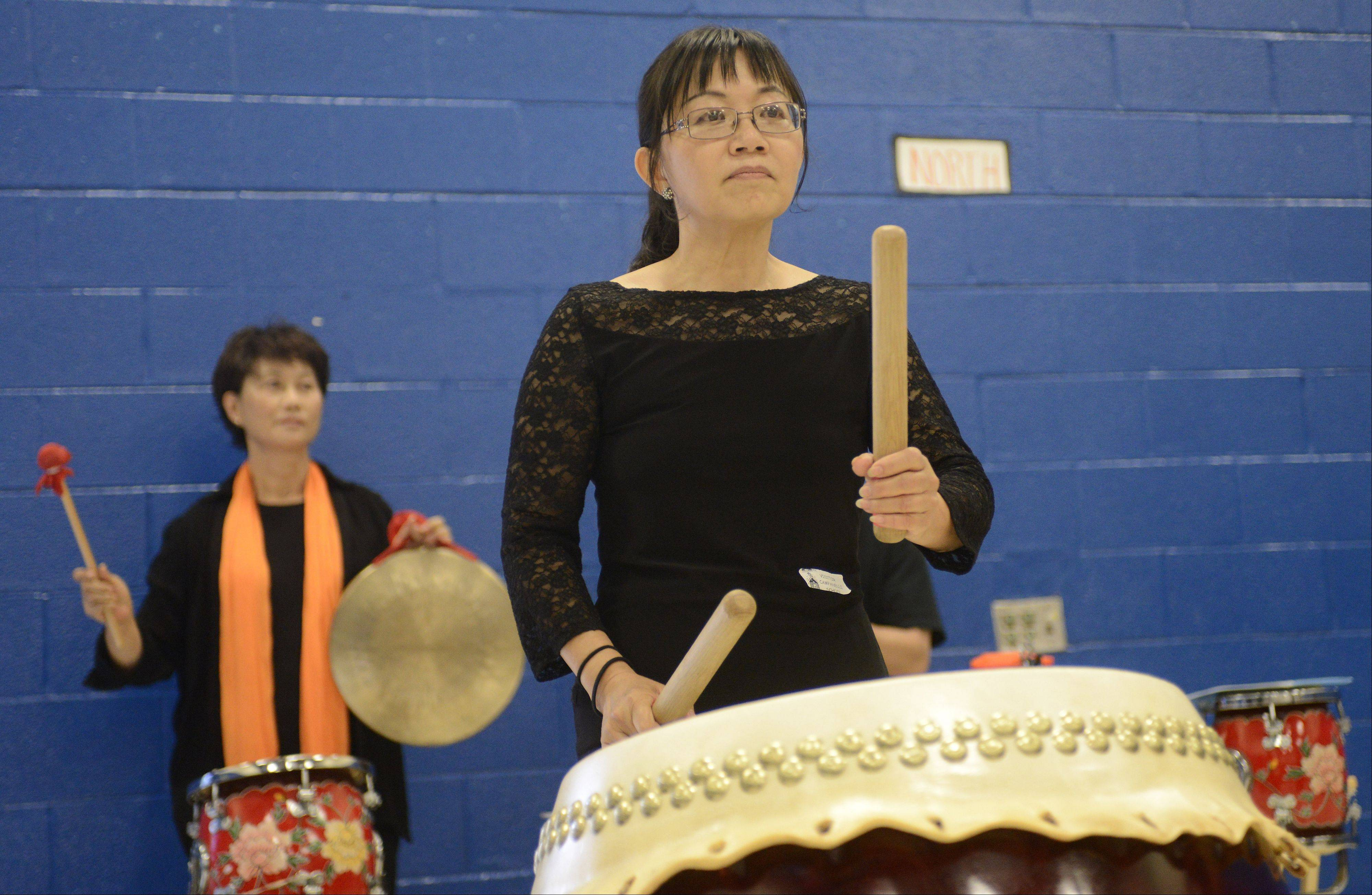 Rose Hong of the Cheng Da Drum Team plays a Chinese drum which was donated Thursday to Campanelli School in Schaumburg by the Taiwanese Overseas Compatriot Affairs Council.