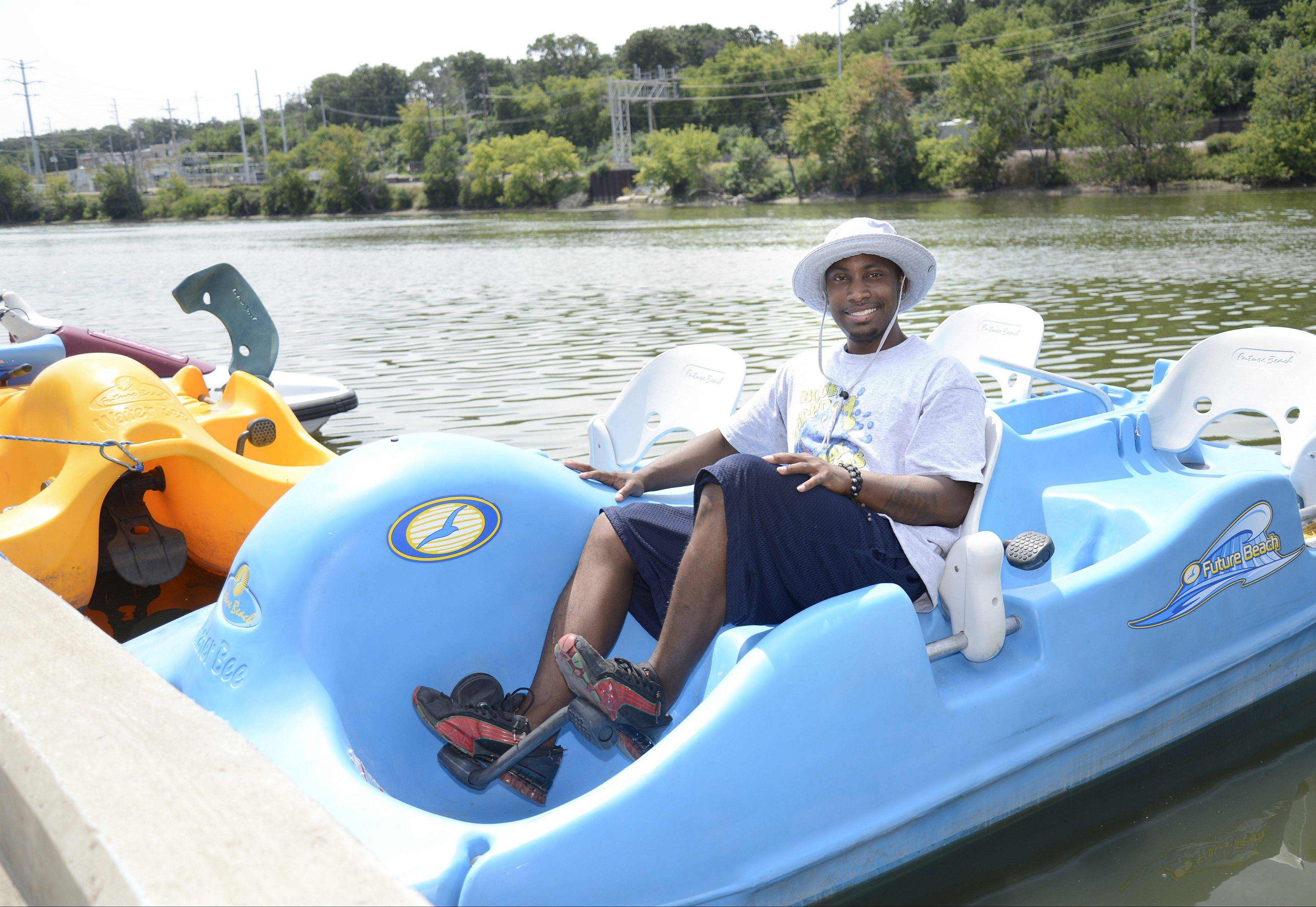 Justin Hodge's Blue Hippo Pedal Boats owns one of at least two businesses to open recently in downtown Elgin, taking advantage of the beauty of the Fox River to attract business.