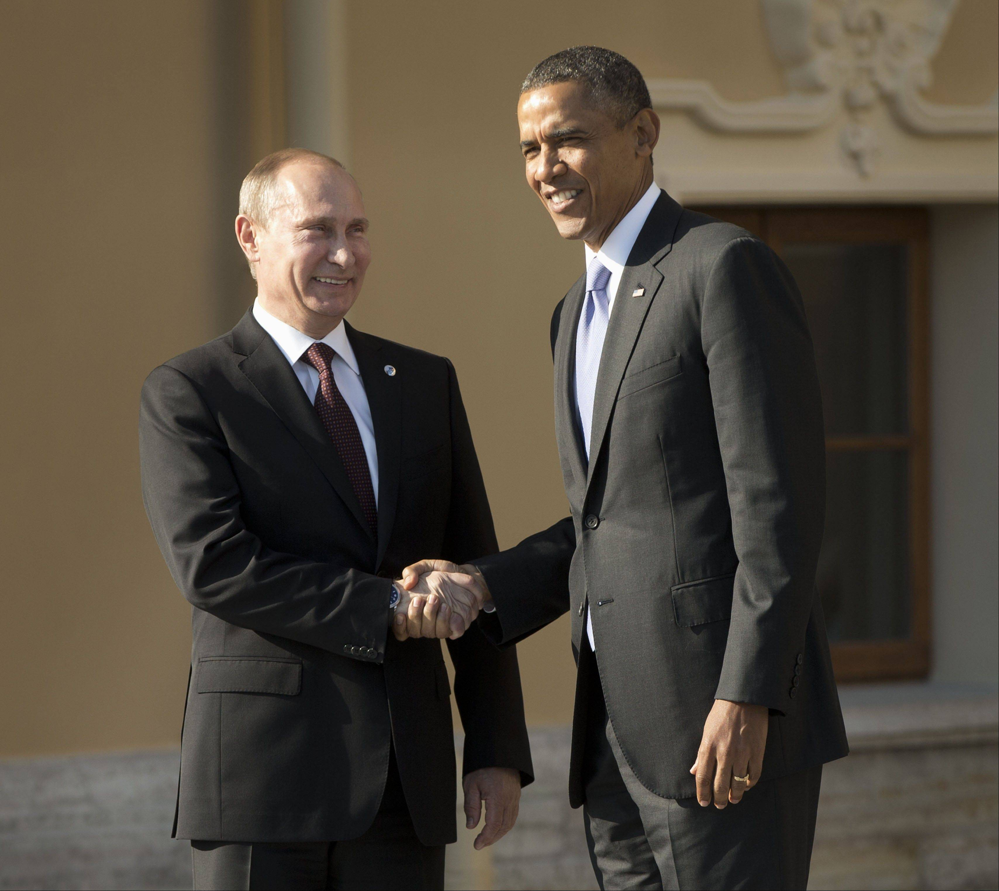 President Barack Obama shakes hands with Russian President Vladimir Putin during arrivals for the G-20 summit at the Konstantin Palace in St. Petersburg, Russia on Thursday, Sept. 5, 2013.